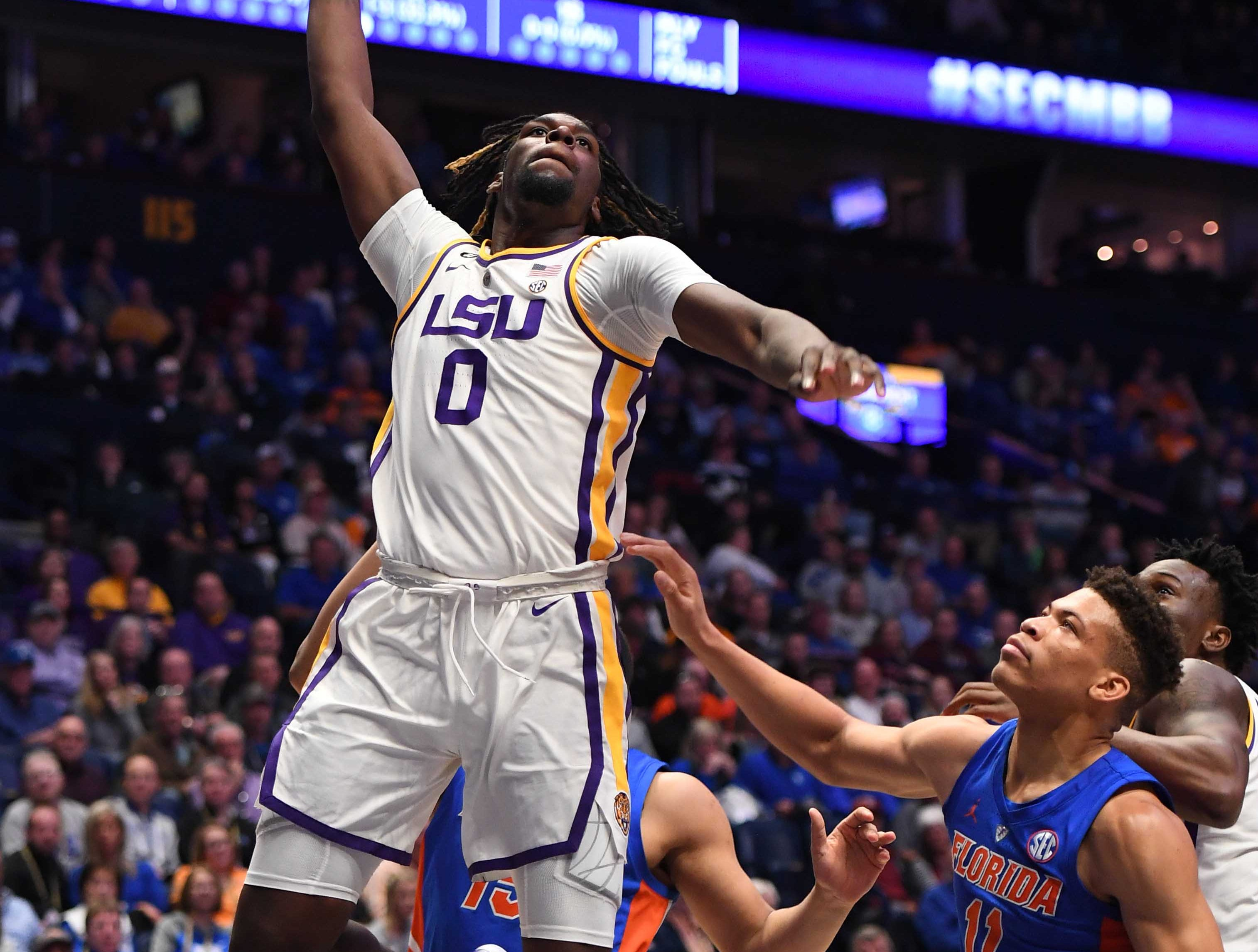 Mar 15, 2019; Nashville, TN, USA; LSU Tigers forward Naz Reid (0) dunks the ball against the Florida Gators during the first half of the SEC conference tournament at Bridgestone Arena. Mandatory Credit: Christopher Hanewinckel-USA TODAY Sports