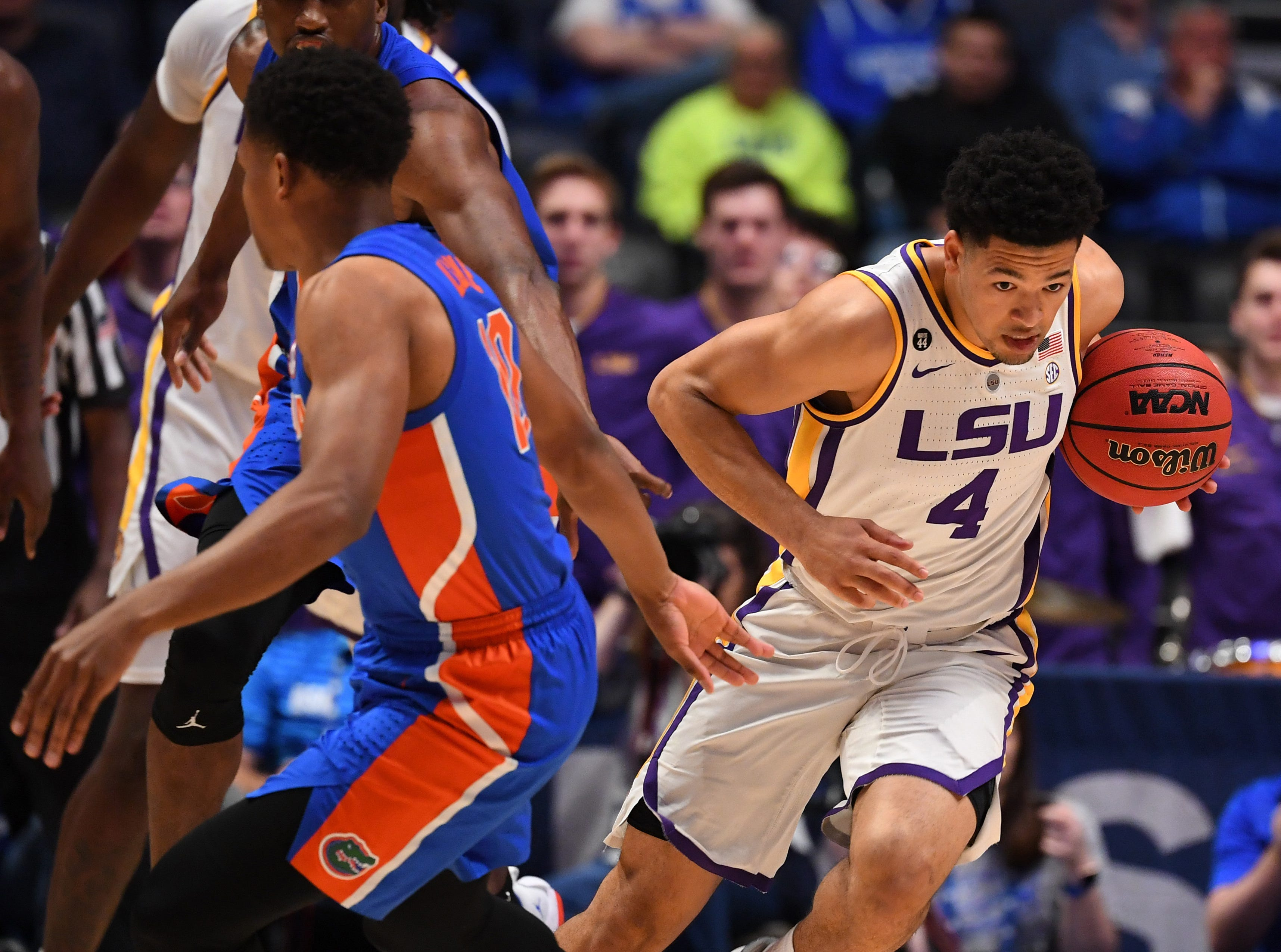 Mar 15, 2019; Nashville, TN, USA; LSU Tigers guard Skylar Mays (4) steals the ball against the Florida Gators during the first half of the SEC conference tournament at Bridgestone Arena. Mandatory Credit: Christopher Hanewinckel-USA TODAY Sports