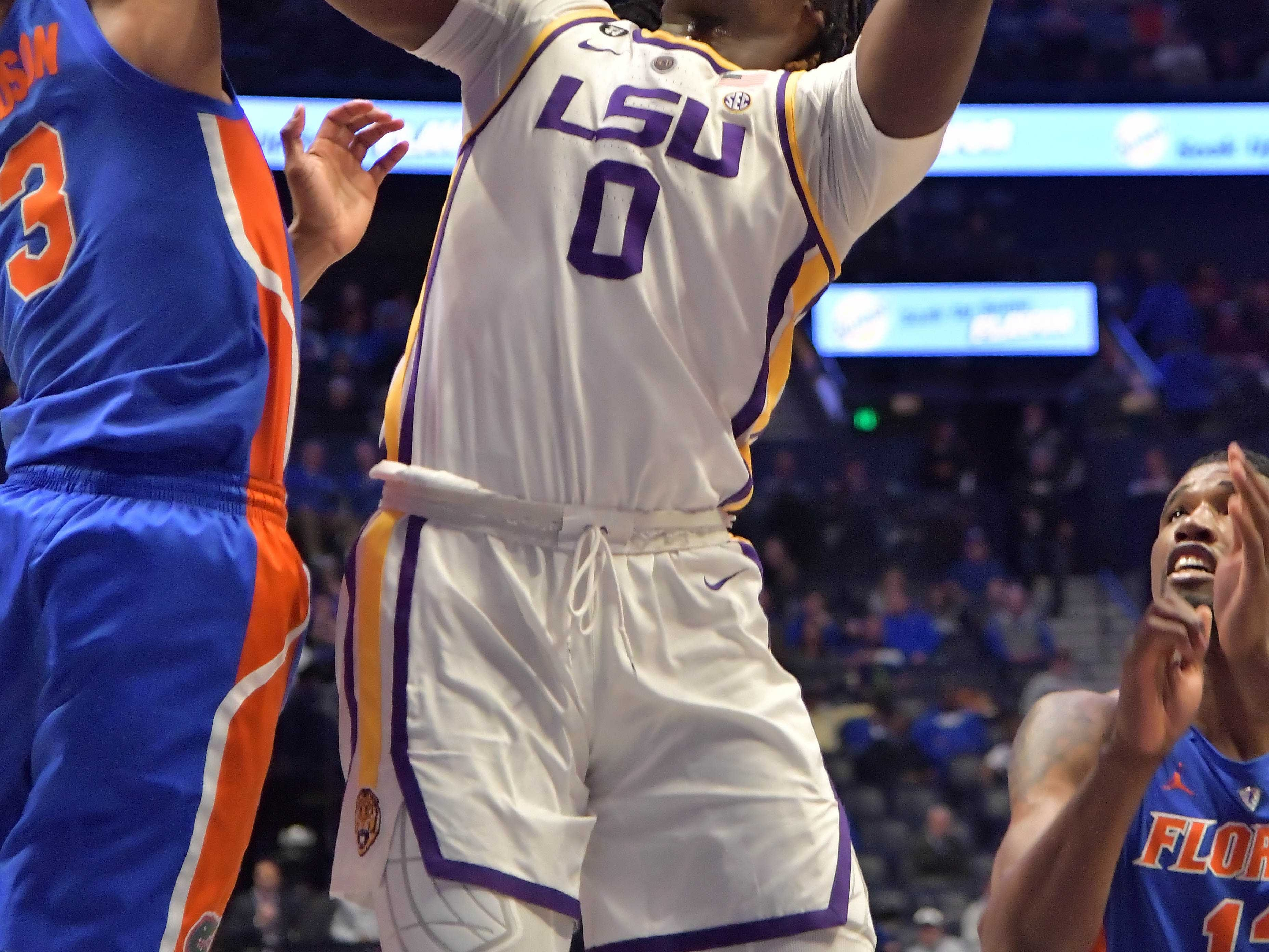 Mar 15, 2019; Nashville, TN, USA; LSU Tigers forward Naz Reid (0) shoots against Florida Gators guard Jalen Hudson (3) during the second half of game seven in the SEC conference tournament at Bridgestone Arena. Mandatory Credit: Jim Brown-USA TODAY Sports
