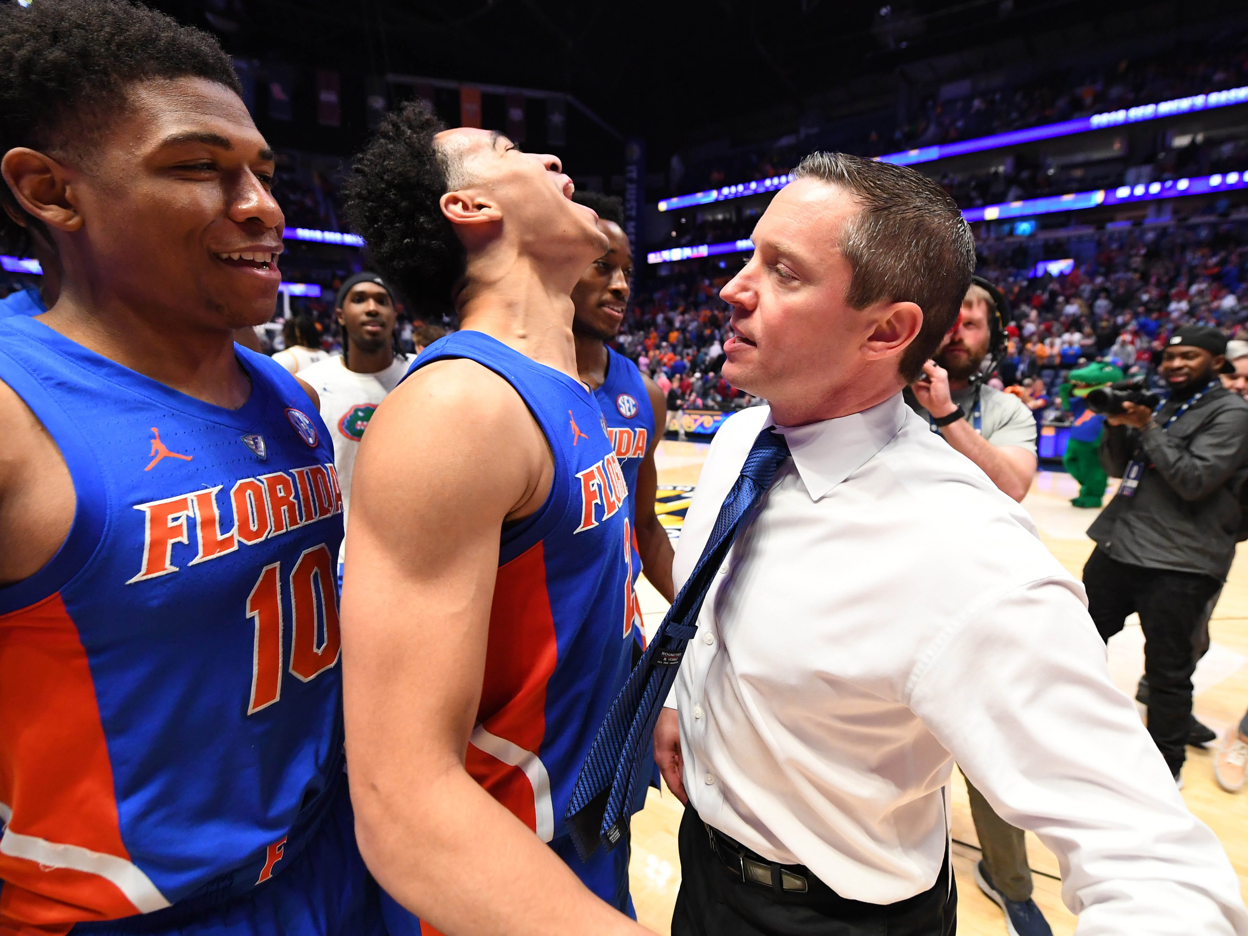 Mar 15, 2019; Nashville, TN, USA; Florida Gators guard Andrew Nembhard (2) celebrates with Florida Gators head coach Mike White after scoring the game winning basket against the LSU Tigers in the SEC conference tournament at Bridgestone Arena. Mandatory Credit: Christopher Hanewinckel-USA TODAY Sports