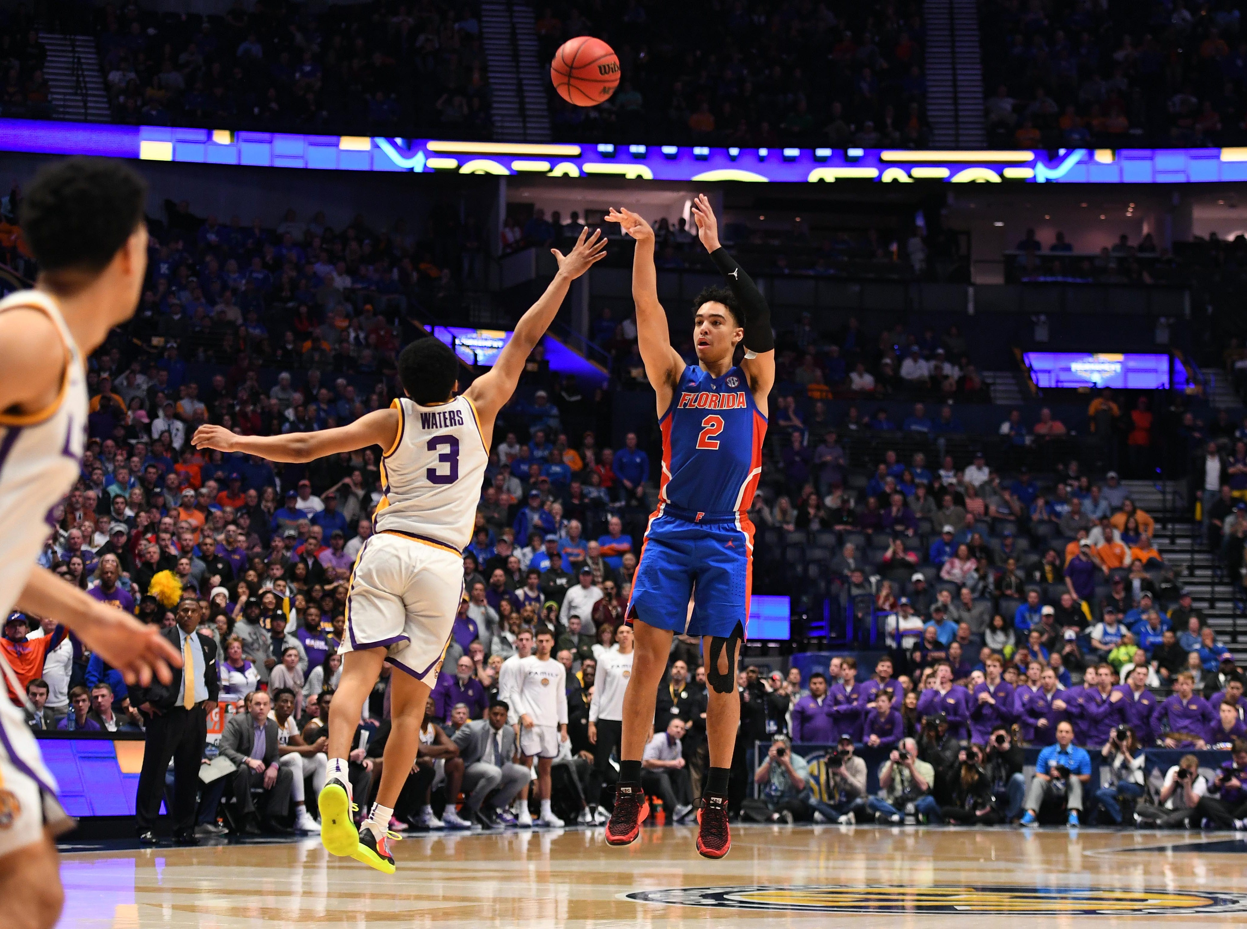 Mar 15, 2019; Nashville, TN, USA; Florida Gators guard Andrew Nembhard (2) shots the game-winning shot over LSU Tigers guard Tremont Waters (3) to advance in the SEC conference tournament at Bridgestone Arena. Mandatory Credit: Christopher Hanewinckel-USA TODAY Sports