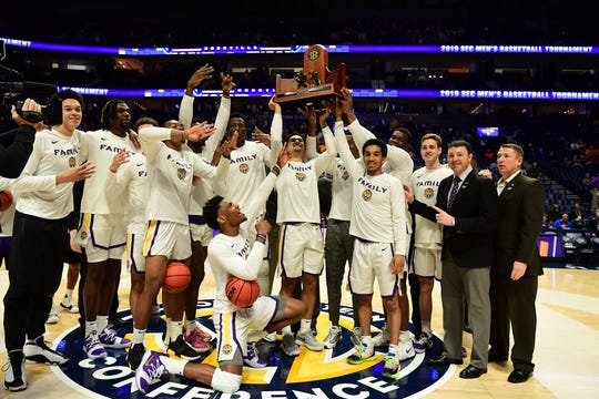 The LSU men's basketball team receives the trophy for winning the Southeastern Conference regular-season title before facing Florida in the SEC Tournament on Friday, March 15, 2019.