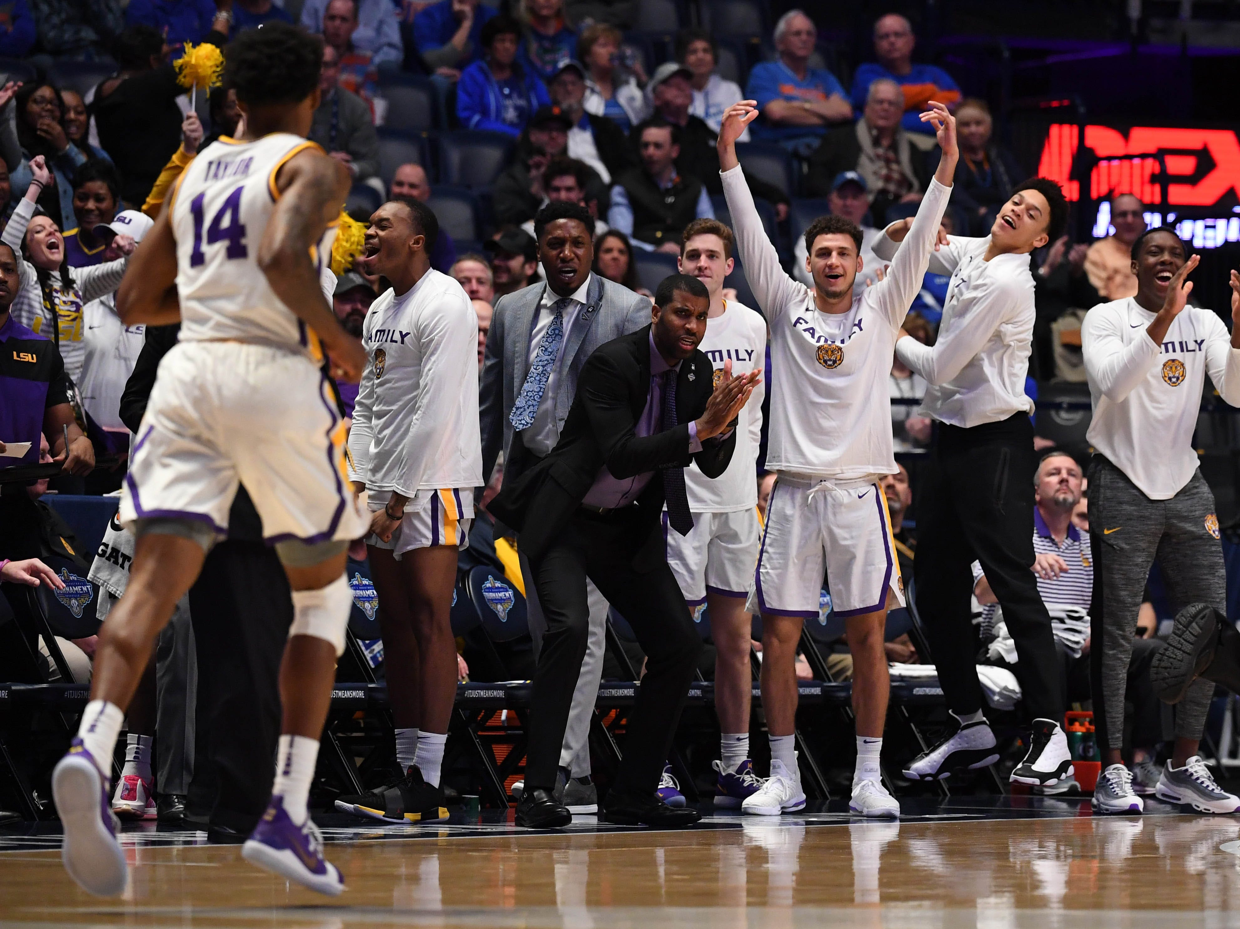 Mar 15, 2019; Nashville, TN, USA; The LSU Tigers players celebrate on the bench against the Florida Gators during the first half of the SEC conference tournament at Bridgestone Arena. Mandatory Credit: Christopher Hanewinckel-USA TODAY Sports