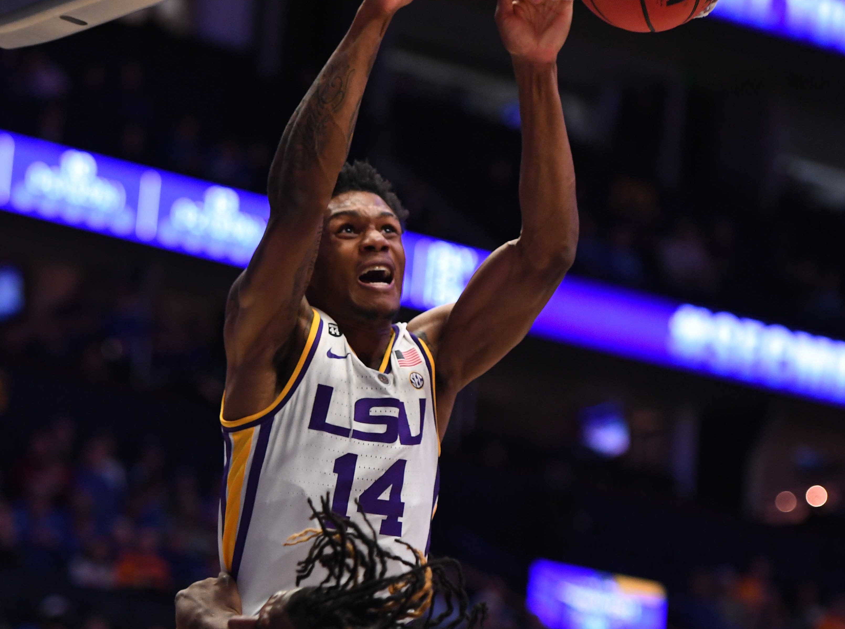 Mar 15, 2019; Nashville, TN, USA; LSU Tigers guard Marlon Taylor (14) dunks the ball against the Florida Gators during the first half of the SEC conference tournament at Bridgestone Arena. Mandatory Credit: Christopher Hanewinckel-USA TODAY Sports