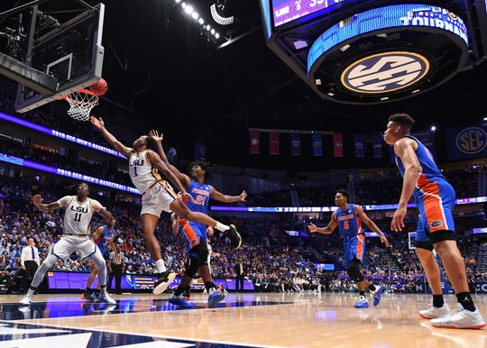Mar 15, 2019; Nashville, TN, USA; LSU Tigers guard Javonte Smart (1) scores in the lane over Florida Gators forward Dontay Bassett (21) during the first half of the SEC conference tournament at Bridgestone Arena. Mandatory Credit: Christopher Hanewinckel-USA TODAY Sports