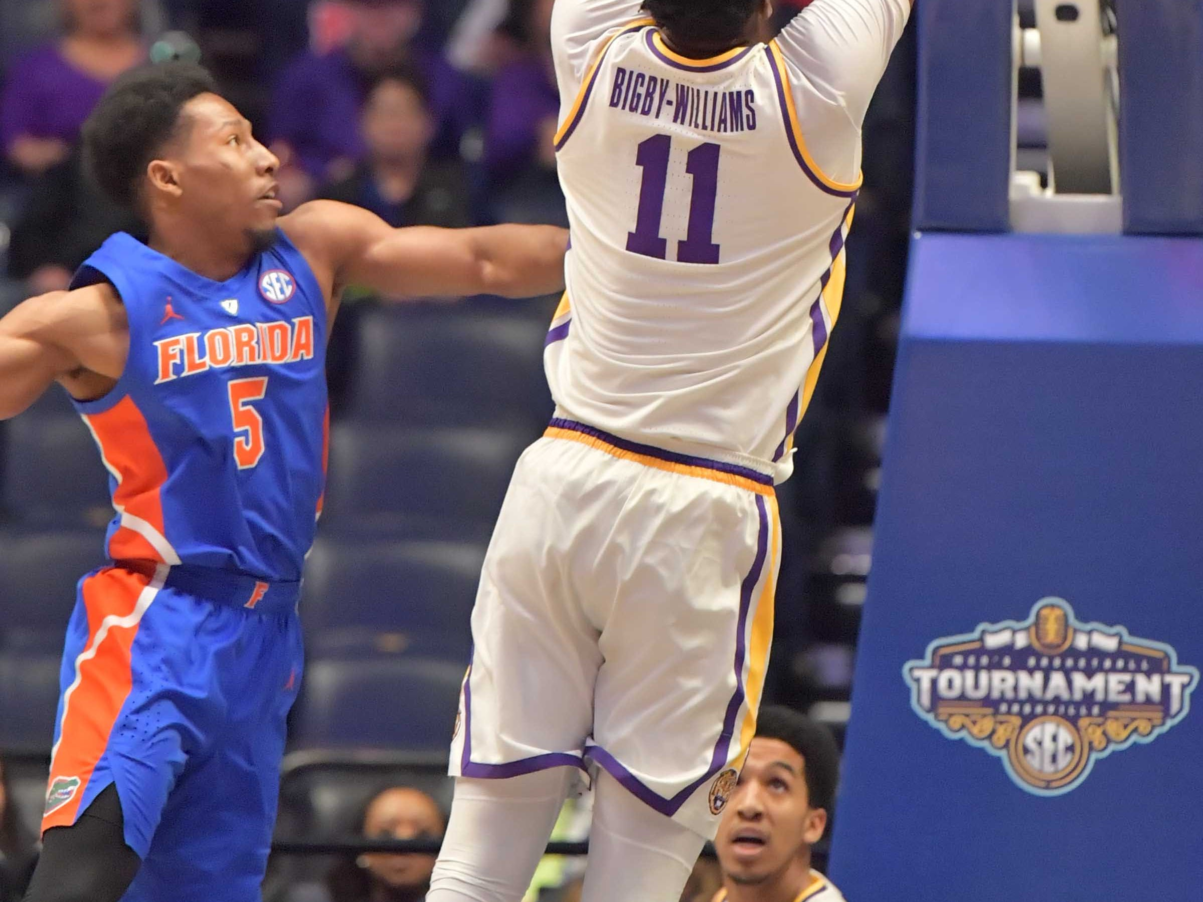 Mar 15, 2019; Nashville, TN, USA; LSU Tigers forward Kavell Bigby-Williams (11) dunks the ball against Florida Gators guard KeVaughn Allen (5) during the first half of game seven in the SEC conference tournament at Bridgestone Arena. Mandatory Credit: Jim Brown-USA TODAY Sports