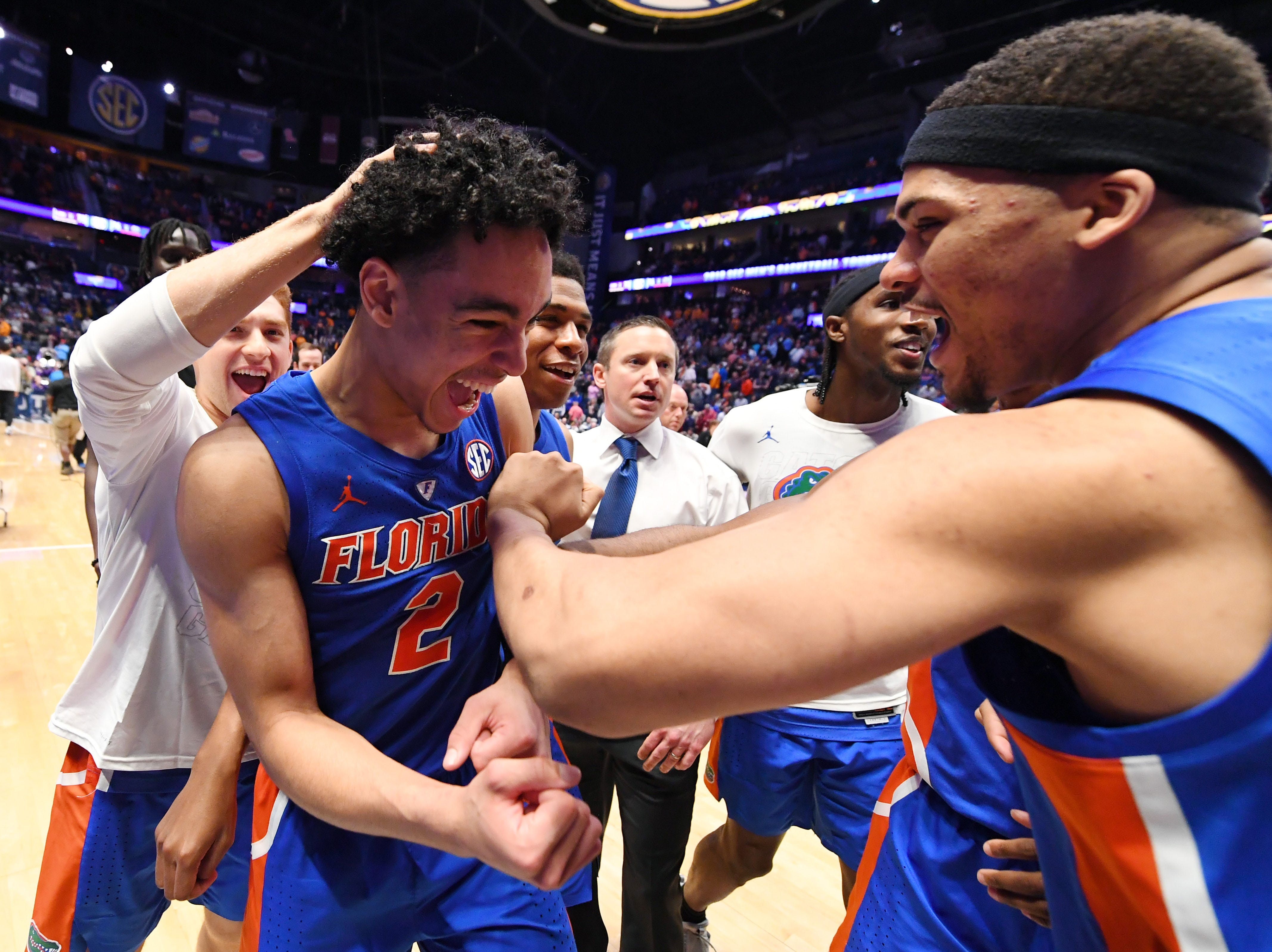 Mar 15, 2019; Nashville, TN, USA; Florida Gators guard Andrew Nembhard (2) celebrates with teammates after scoring the game basket against the LSU Tigers in the SEC conference tournament at Bridgestone Arena. Mandatory Credit: Christopher Hanewinckel-USA TODAY Sports