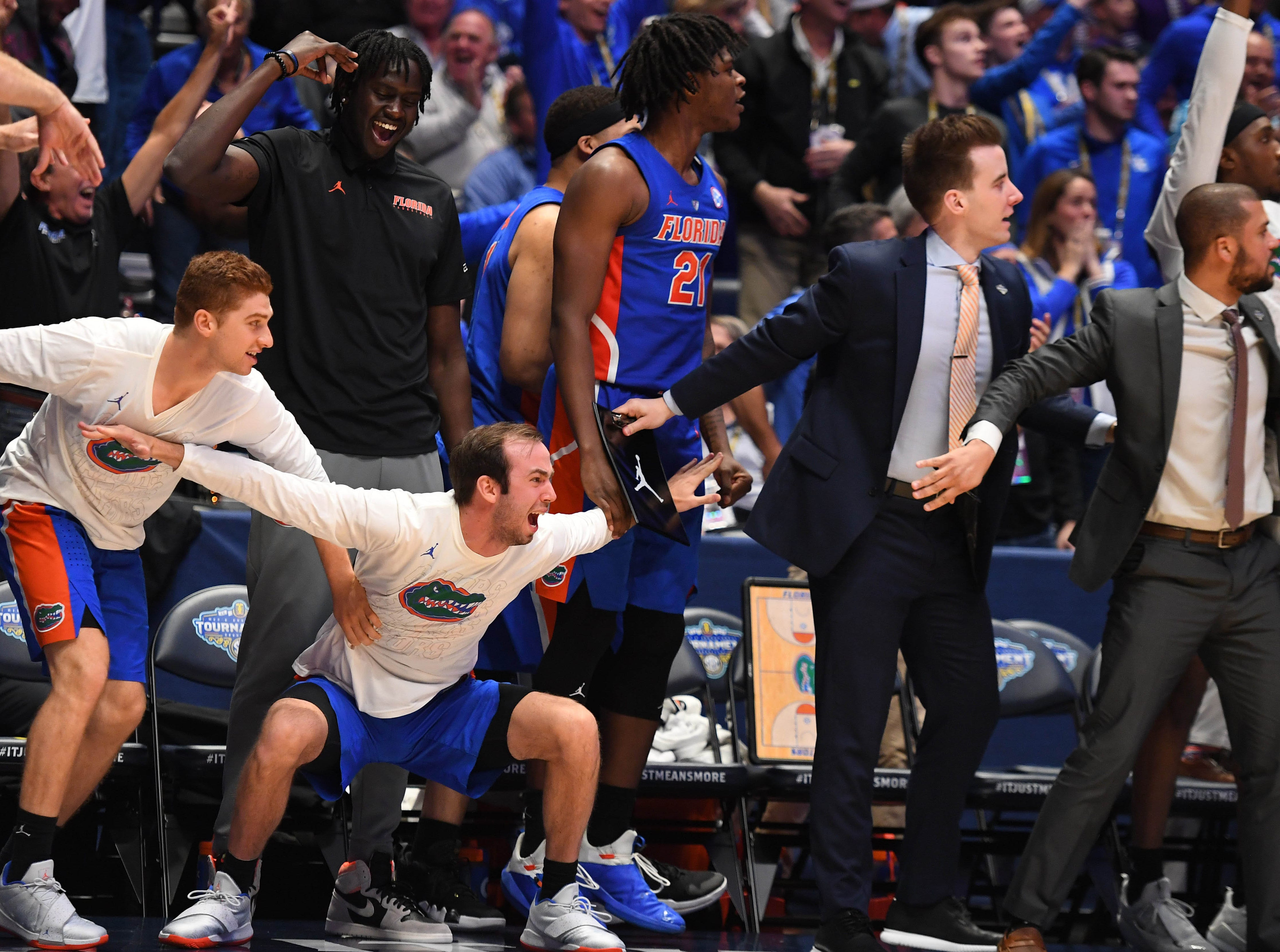 Mar 15, 2019; Nashville, TN, USA; The Florida Gators bench reacts after a game-winning shot by Florida Gators guard Andrew Nembhard (not pictured) during the second half against the LSU Tigers in the SEC conference tournament at Bridgestone Arena. Mandatory Credit: Christopher Hanewinckel-USA TODAY Sports