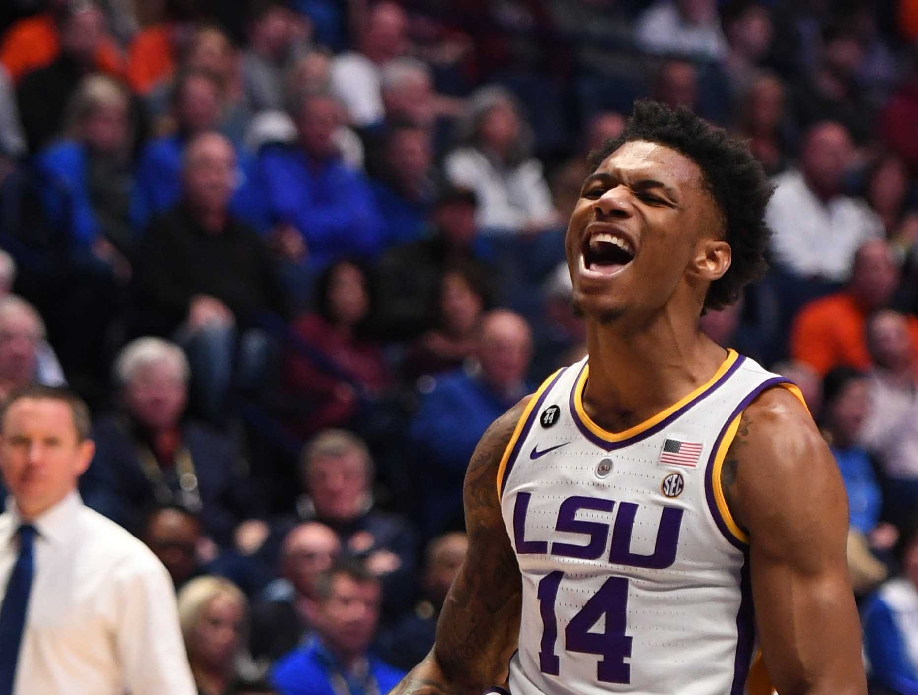 Mar 15, 2019; Nashville, TN, USA; LSU Tigers guard Marlon Taylor (14) celebrates after a dunk against the Florida Gators during the first half of the SEC conference tournament at Bridgestone Arena. Mandatory Credit: Christopher Hanewinckel-USA TODAY Sports