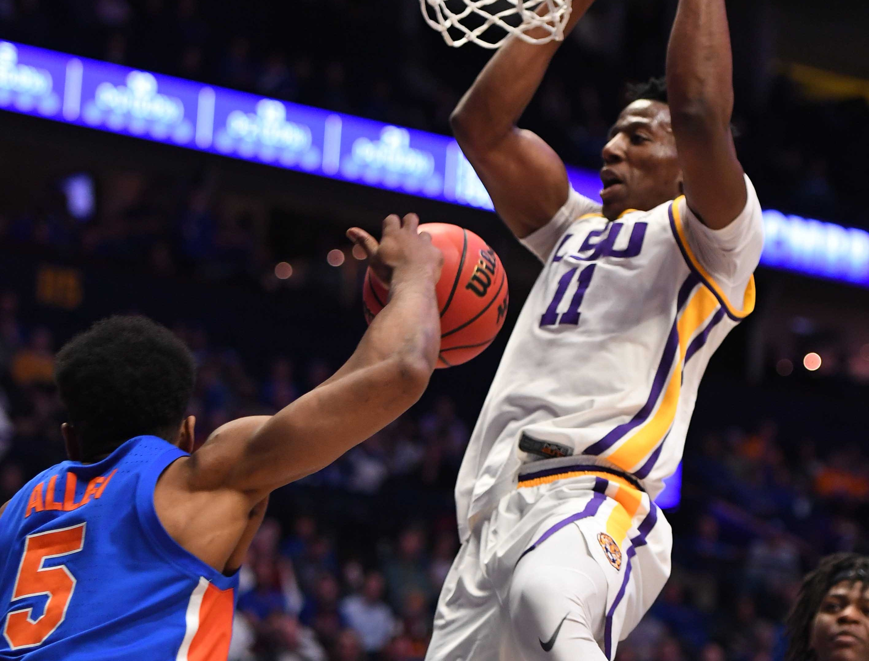 Mar 15, 2019; Nashville, TN, USA; LSU Tigers forward Kavell Bigby-Williams (11) dunks over Florida Gators guard KeVaughn Allen (5) during the first half of the SEC conference tournament at Bridgestone Arena. Mandatory Credit: Christopher Hanewinckel-USA TODAY Sports