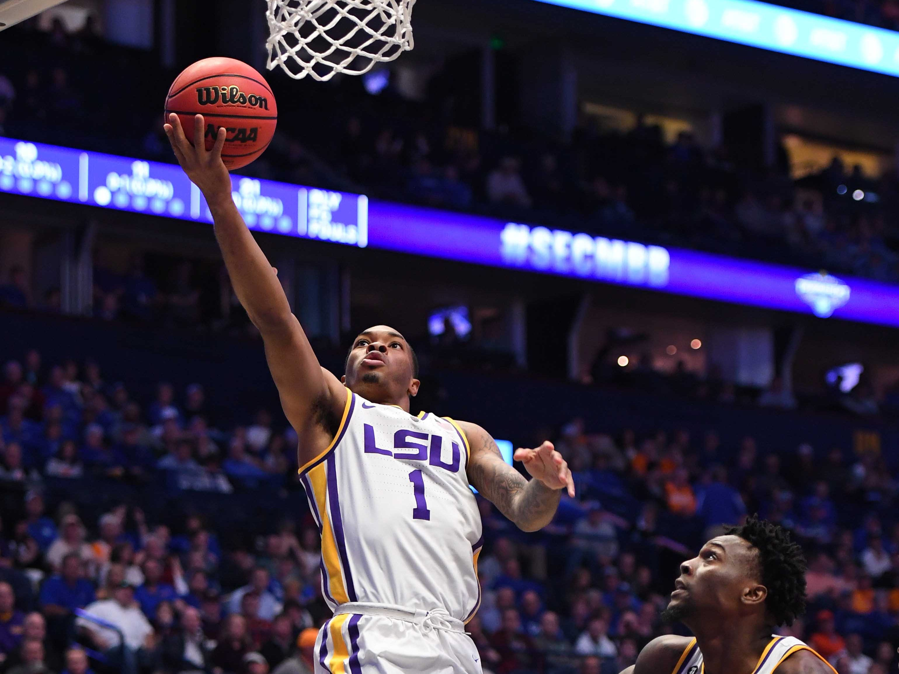 Mar 15, 2019; Nashville, TN, USA; LSU Tigers guard Javonte Smart (1) makes a layup against the Florida Gators during the first half of the SEC conference tournament at Bridgestone Arena. Mandatory Credit: Christopher Hanewinckel-USA TODAY Sports
