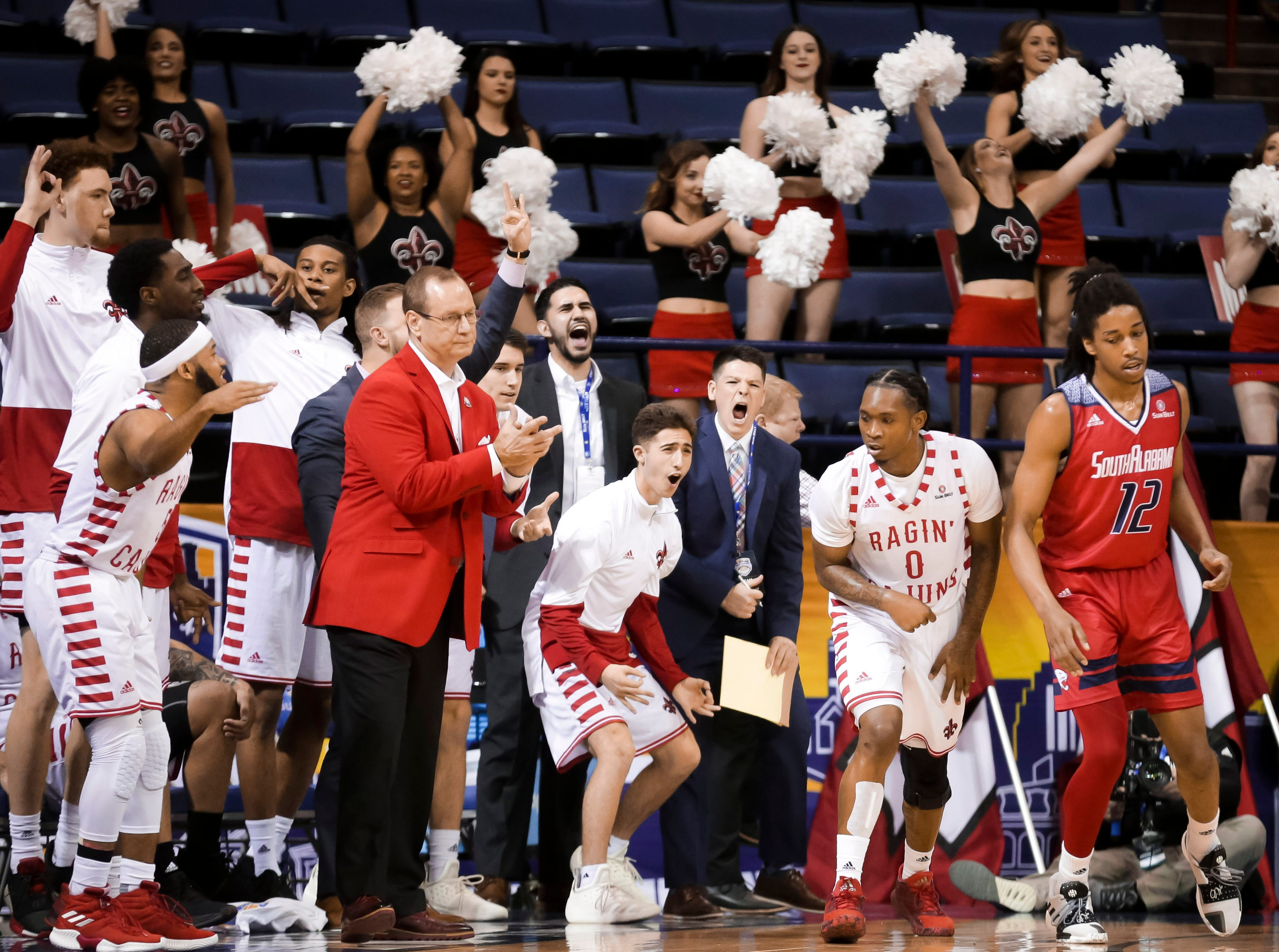 UL's bench cheers Thursday against South Alabama at the Sun Belt Men's Basketball Championship in New Orleans.