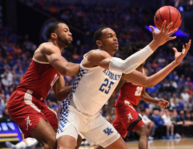 Mar 15, 2019; Nashville, TN, USA; Kentucky Wildcats forward PJ Washington (25) catches the ball in the post against Alabama Crimson Tide forward Galin Smith (30) during the first half of the SEC conference tournament at Bridgestone Arena. Mandatory Credit: Christopher Hanewinckel-USA TODAY Sports