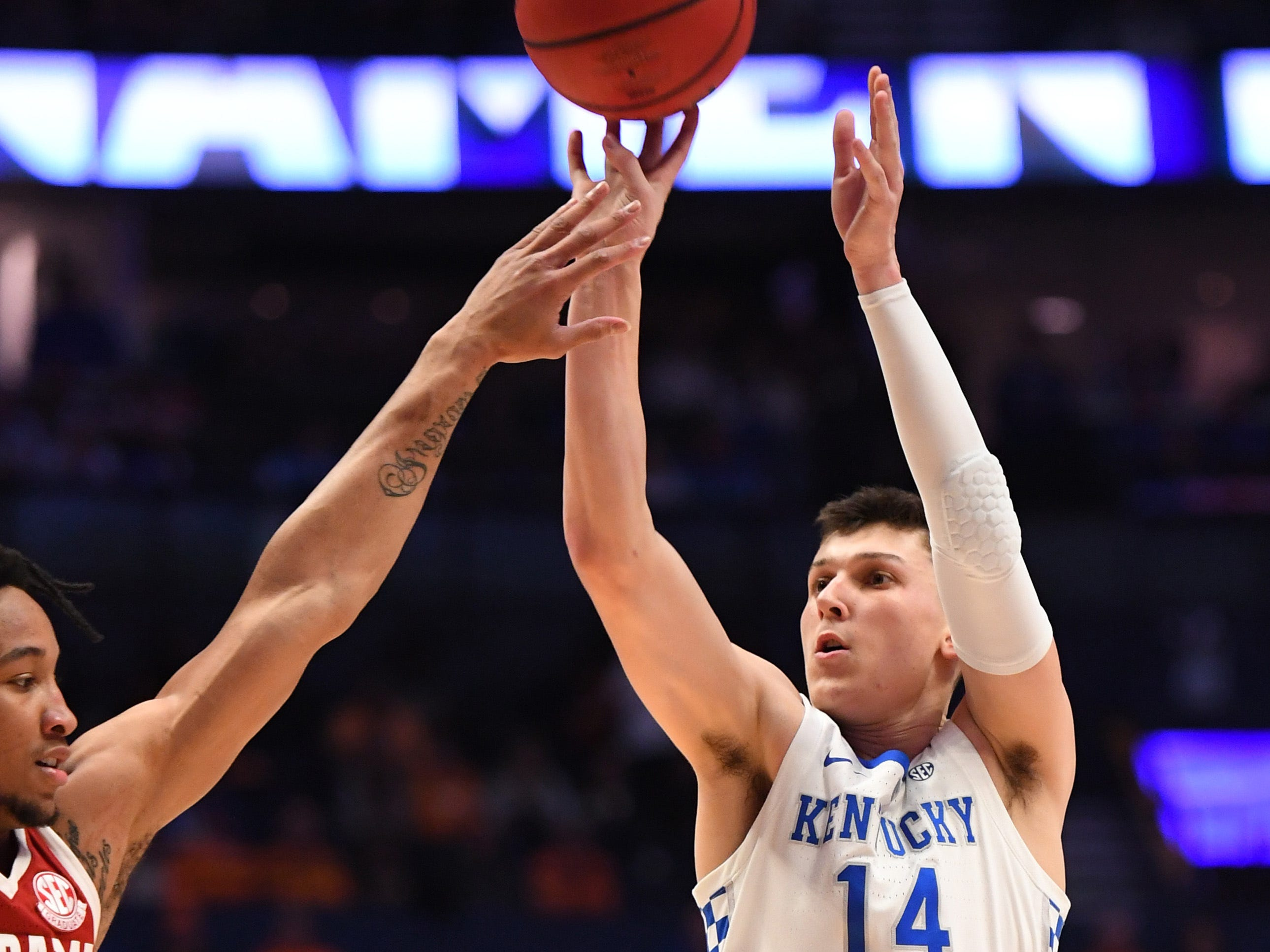 Mar 15, 2019; Nashville, TN, USA; Kentucky Wildcats guard Tyler Herro (14) scores a three point basket during the first half against the Alabama Crimson Tide in the SEC conference tournament at Bridgestone Arena. Mandatory Credit: Christopher Hanewinckel-USA TODAY Sports
