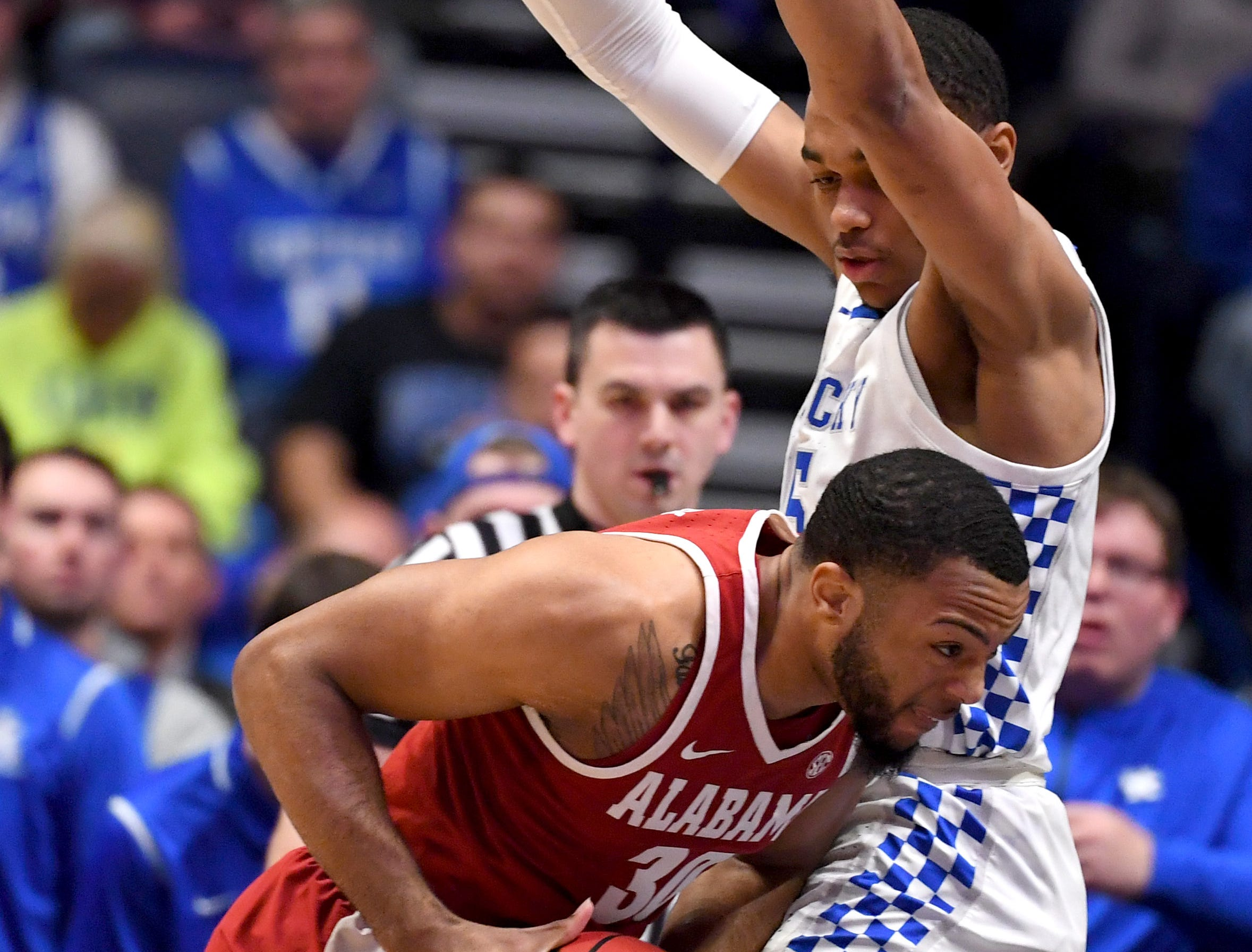 Mar 15, 2019; Nashville, TN, USA; Alabama Crimson Tide forward Galin Smith (30) works against Kentucky Wildcats forward PJ Washington (25) during the first half of the SEC conference tournament at Bridgestone Arena. Mandatory Credit: Christopher Hanewinckel-USA TODAY Sports