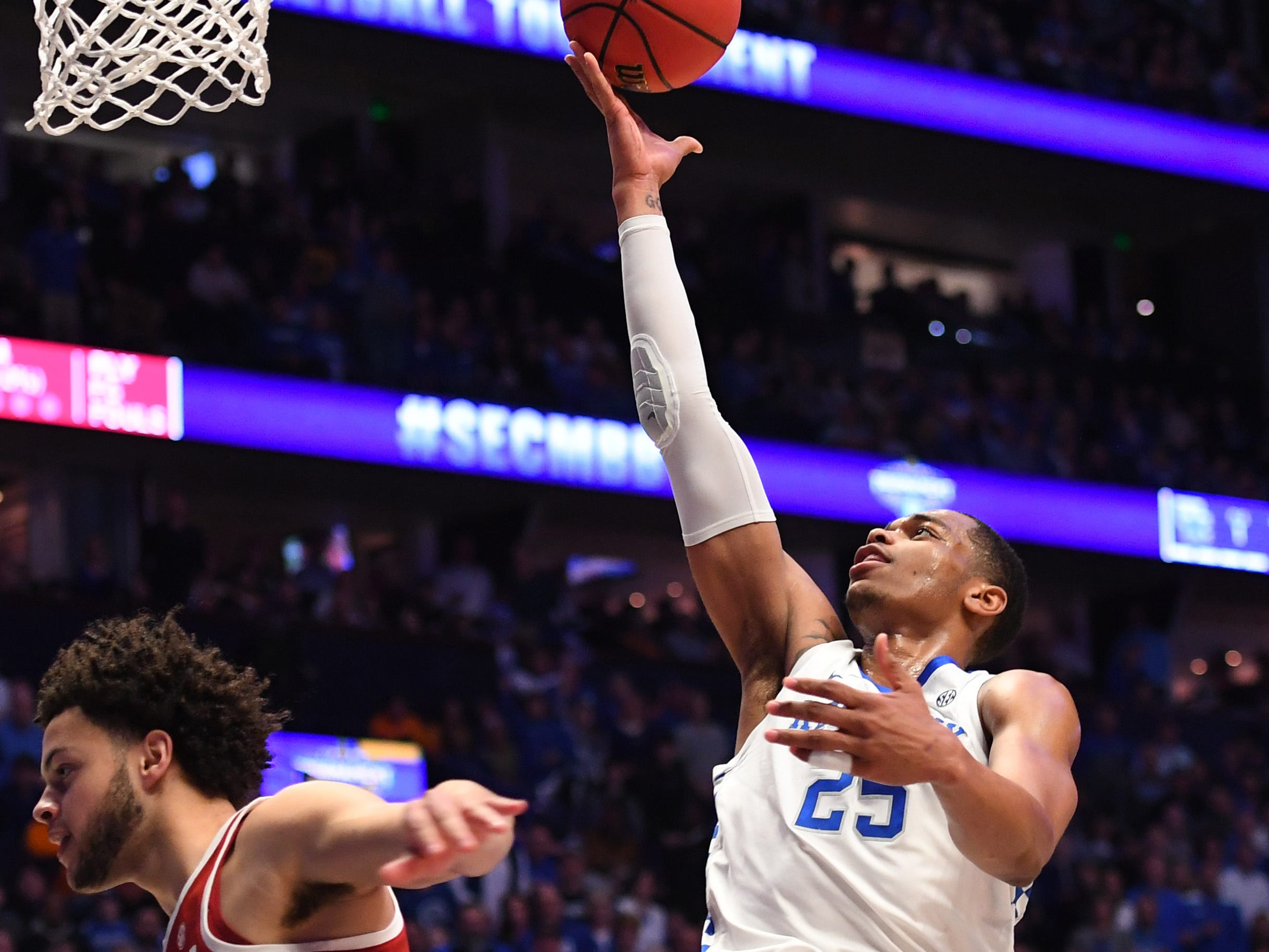 Mar 15, 2019; Nashville, TN, USA; Kentucky Wildcats forward PJ Washington (25) shoots as he is fouled by Alabama Crimson Tide forward Alex Reese (3) during the first half of the SEC conference tournament at Bridgestone Arena. Mandatory Credit: Christopher Hanewinckel-USA TODAY Sports
