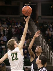 Howell's Cody Deurloo gets his hand on the opening tip against Emoni Bates of Ypsilanti Lincoln in a state Division 1 basketball semifinal at the Breslin Center on Friday, March 15, 2019.