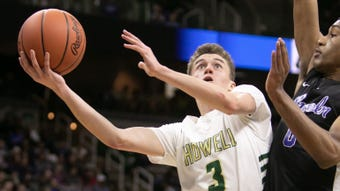 Highlights, interviews from Howell's state semifinal basketball loss to Emoni Bates and Ypsilanti Lincoln.