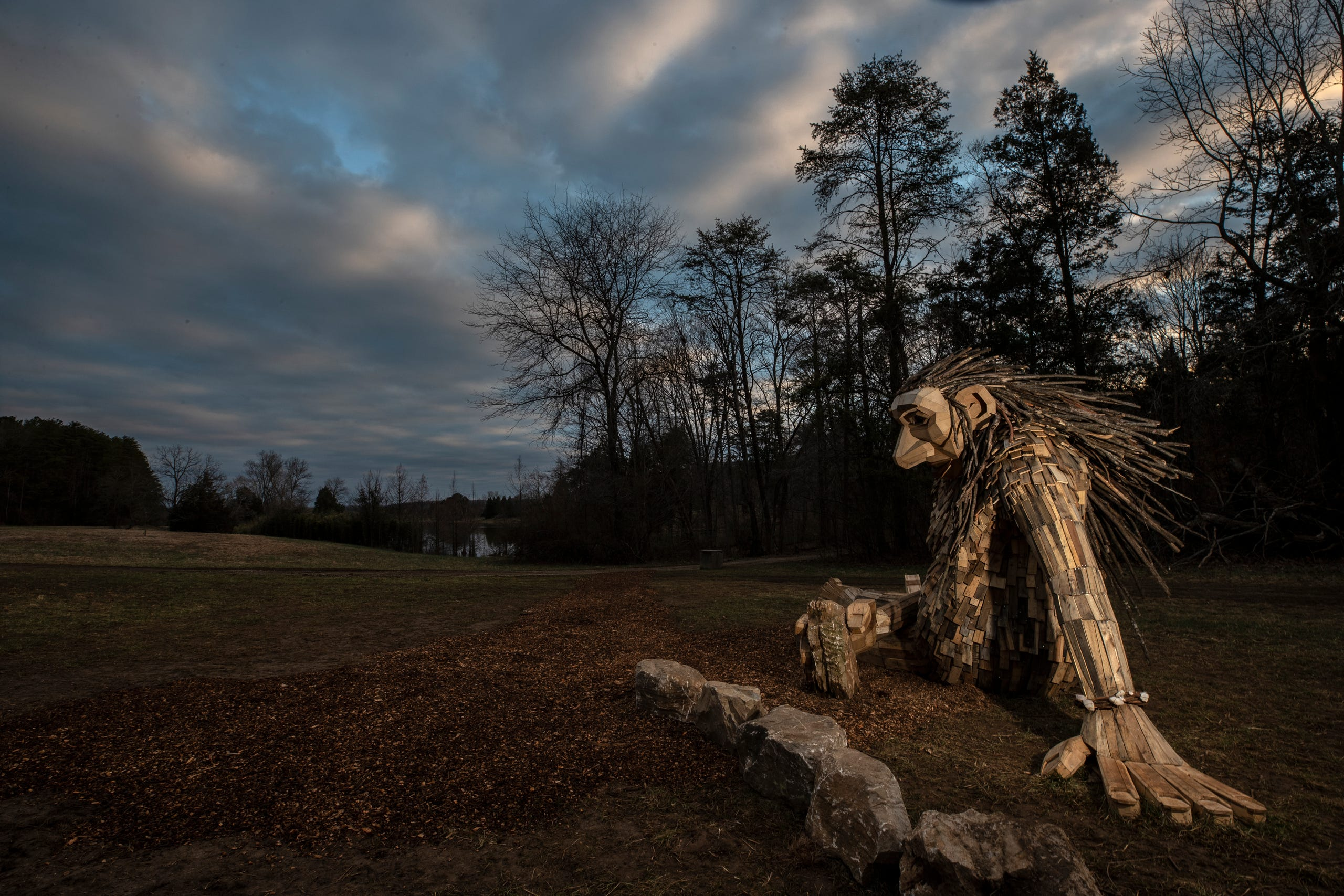 Little Elina, one of three giant trolls, reclines in a field in Bernheim Forest. March 15, 2019.