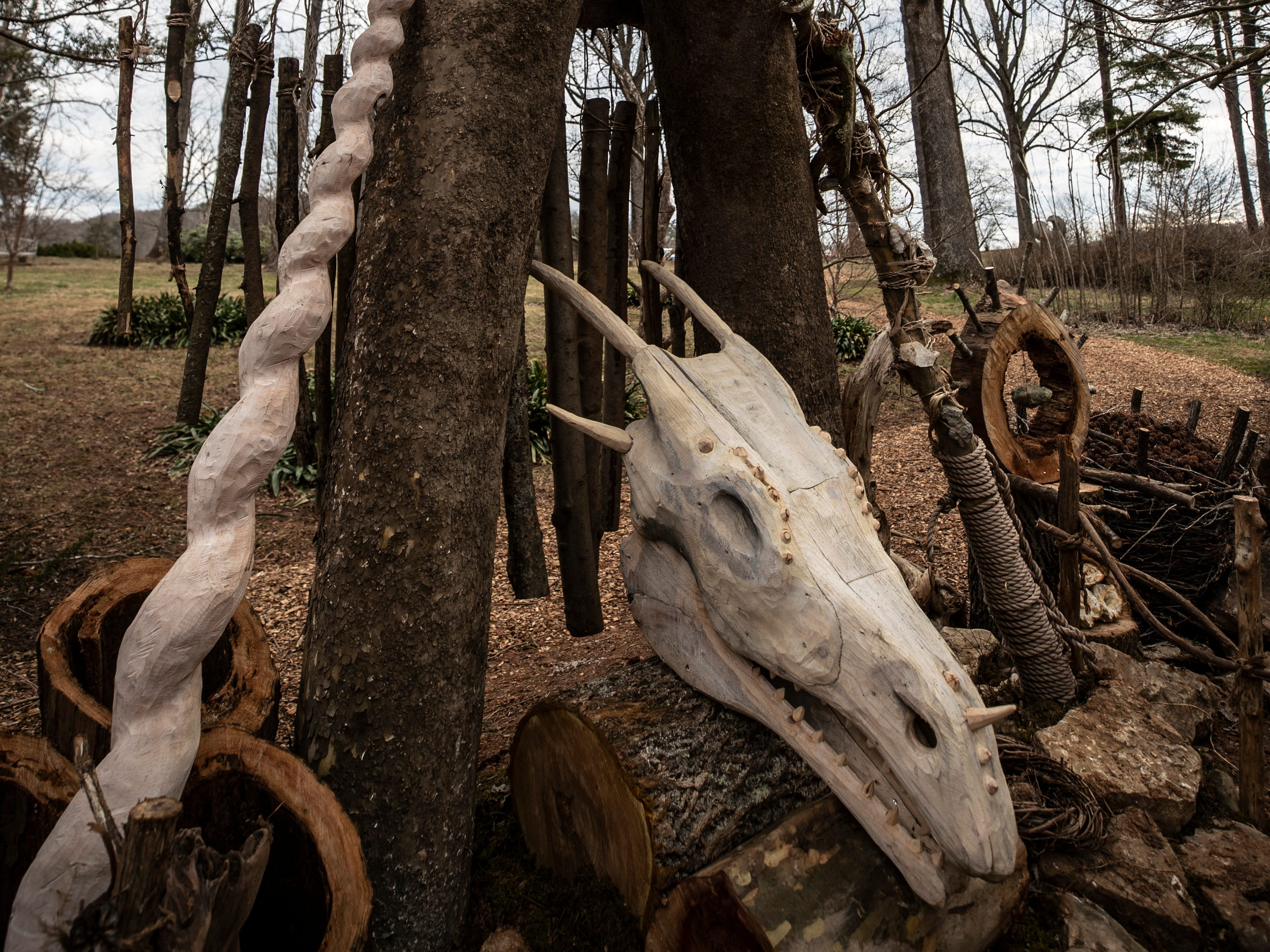 An altar created by artist Thomas Dambo at Bernheim Forest for the pregnant giant troll, Mamma Loumari includes a unicorn's horn and a dragon's head. The items are from Scandinavian folklore involving trolls. March 15, 2019.