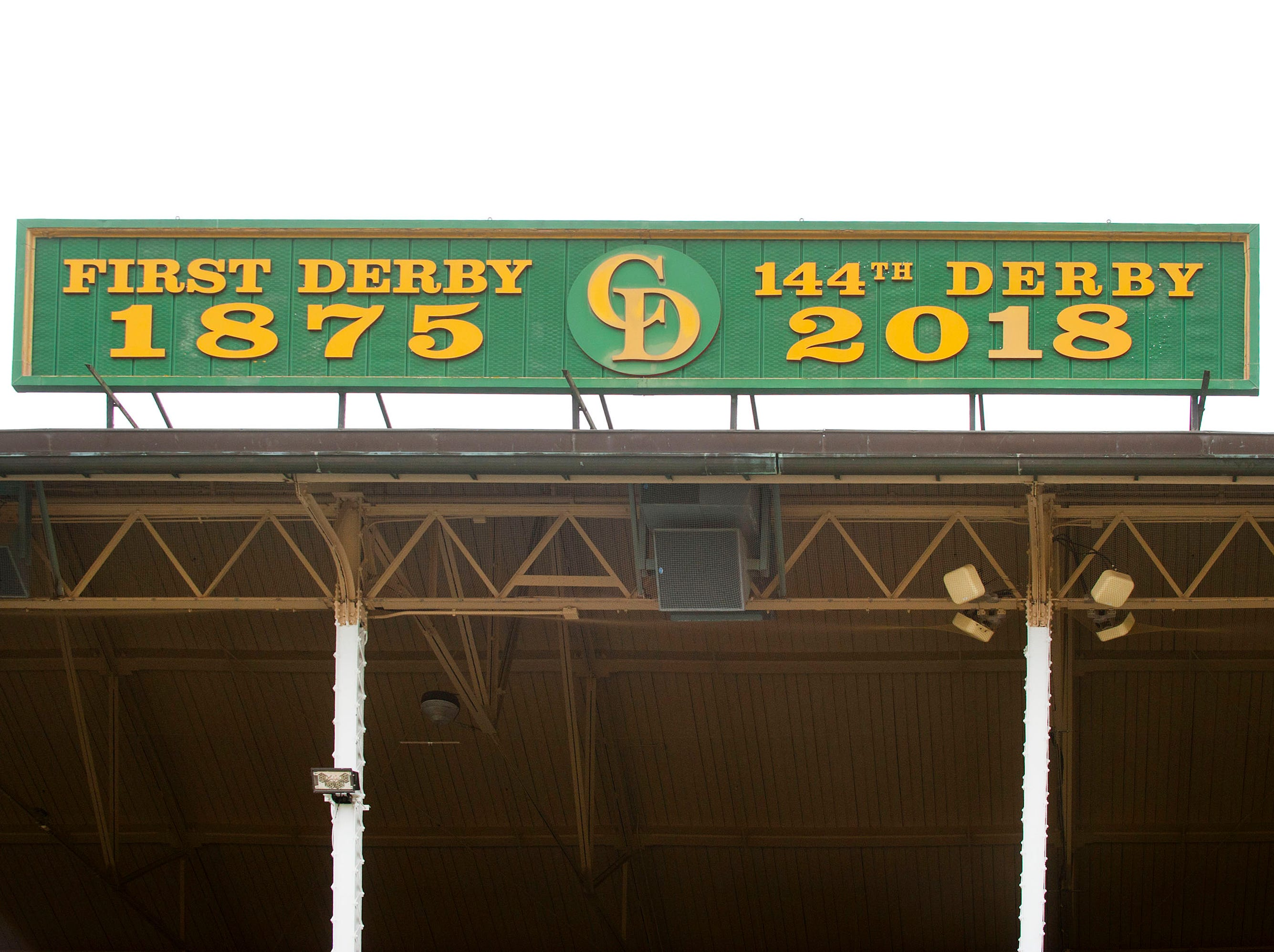 The Churchill Downs sign hung between the twin spires signifying last year's running of the Kentucky Derby. The sign was updated today to reflect the new year of racing.