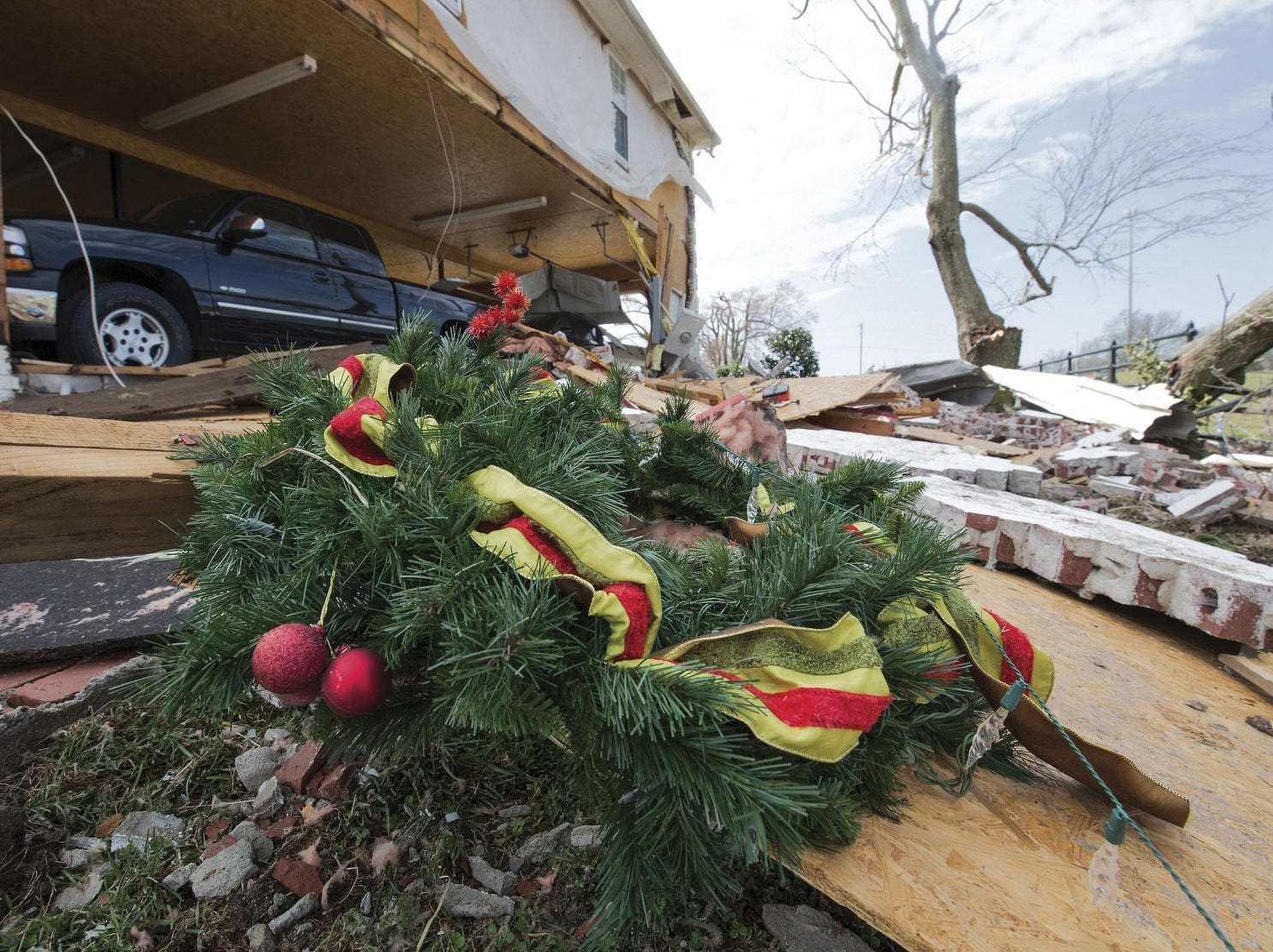 The wall of this home was blown out when a devastating tornado touched down off Hamburg Road in McCracken County, Ky., on Thursday, March 14, 2019.