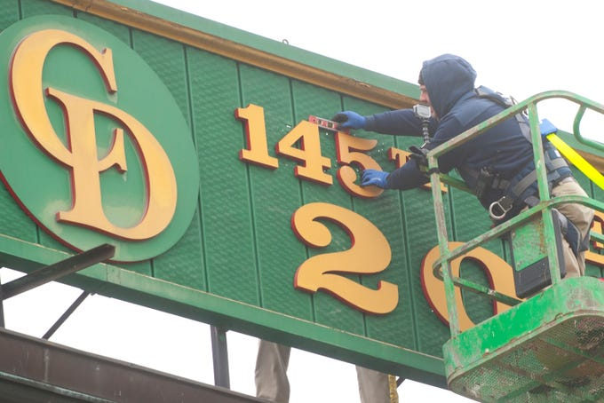 """Churchill Downs sign shop worker Todd Herl replaces the number 4 and levels the number 5 in a sign hung between the twin spires signifying the 145th year of the running of the Kentucky Derby.  The sign says """"First Derby, 1875, 145th Derby, 2019.15 March 2019"""