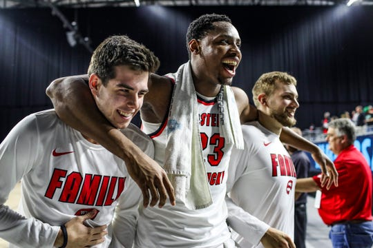 Western Kentucky center Charles Bassey (23) hugs guard Patrick Murphy and forward Carson Williams after the team's win over North Texas during an NCAA college basketball game Thursday, March 14, 2019, in the Conference USA men's tournament in Frisco, Texas.