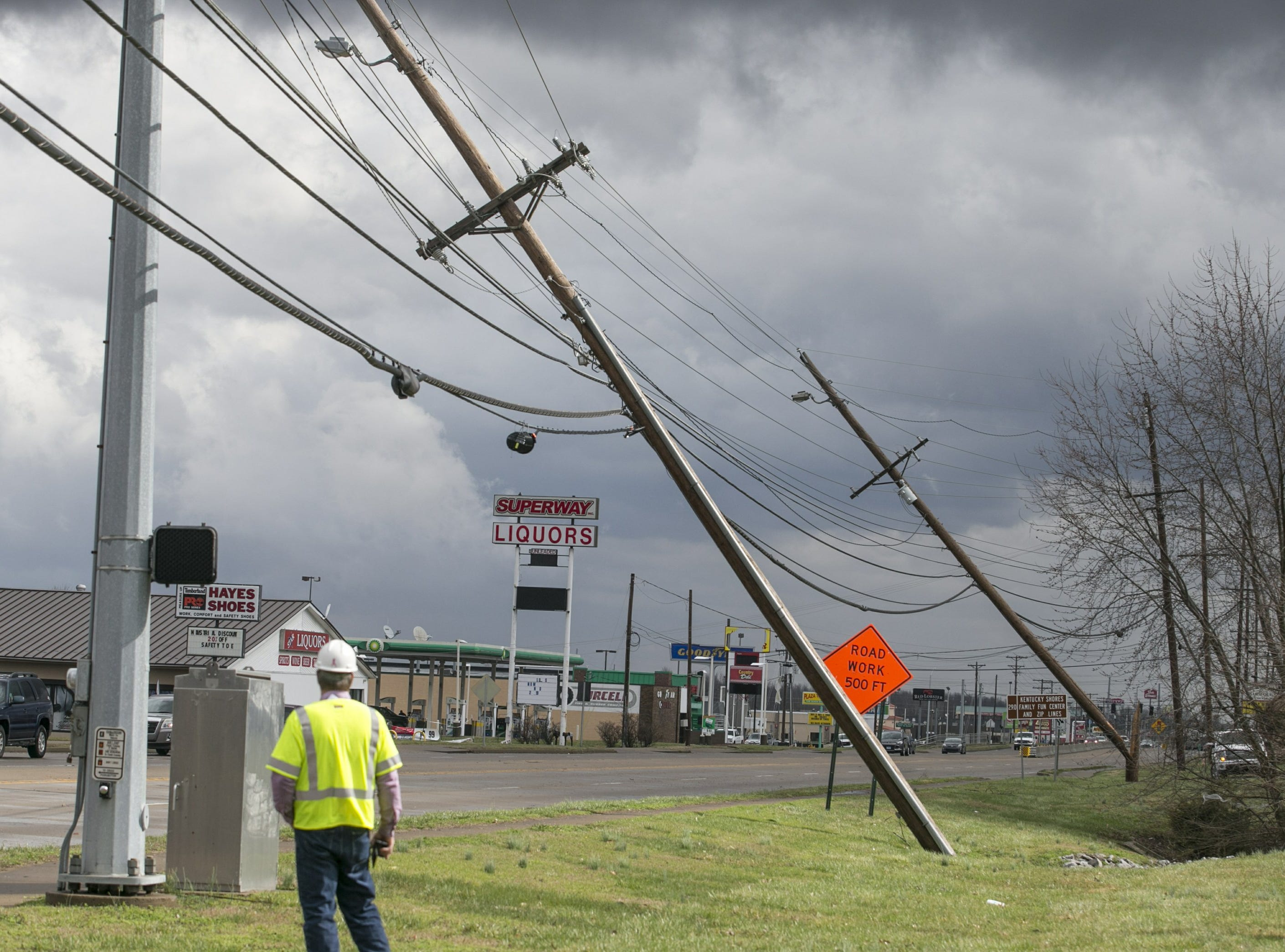Power lines are down in Paducah, Ky. on Thursday, March 14, 2019. This Thursday, March 14, 2019 photo shows damage to the Wilbert Vault Co., in West Paducah, Ky. A tornado left a path in western Kentucky from Lovelaceville through the West Paducah area, according to Keith Todd, a spokesman for the Kentucky Transportation Cabinet. He said the public was being asked to avoid the area while utility crews, area fire departments, and rescue squads worked to clear utility lines, downed trees and other debris.
