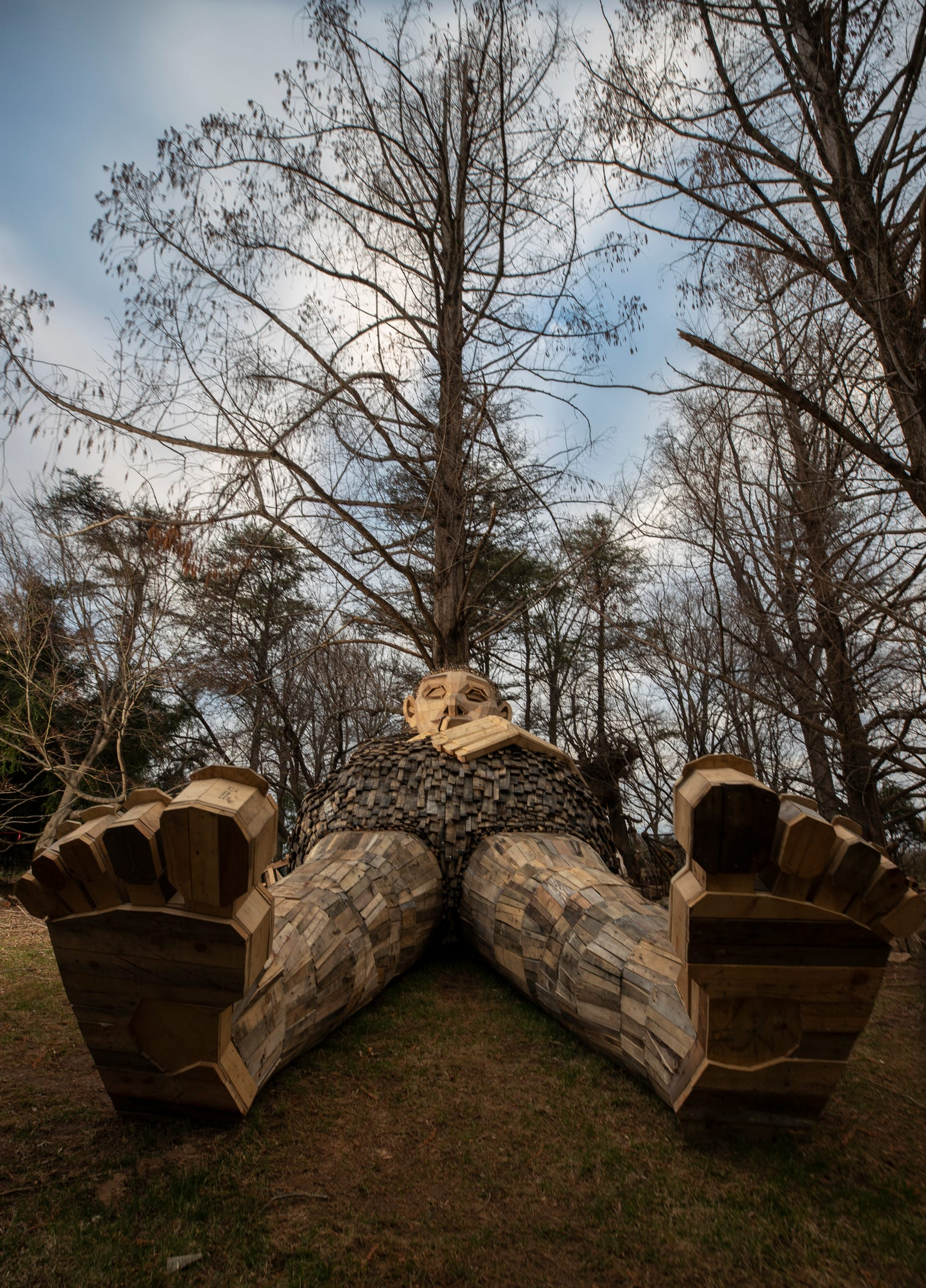 A pregnant Momma Loumari rests against a redwood tree. The giant troll and her two children have taken up residence in Bernheim Forest. The sculpture is the work of Artist Thomas Dambo. March 15, 2019.