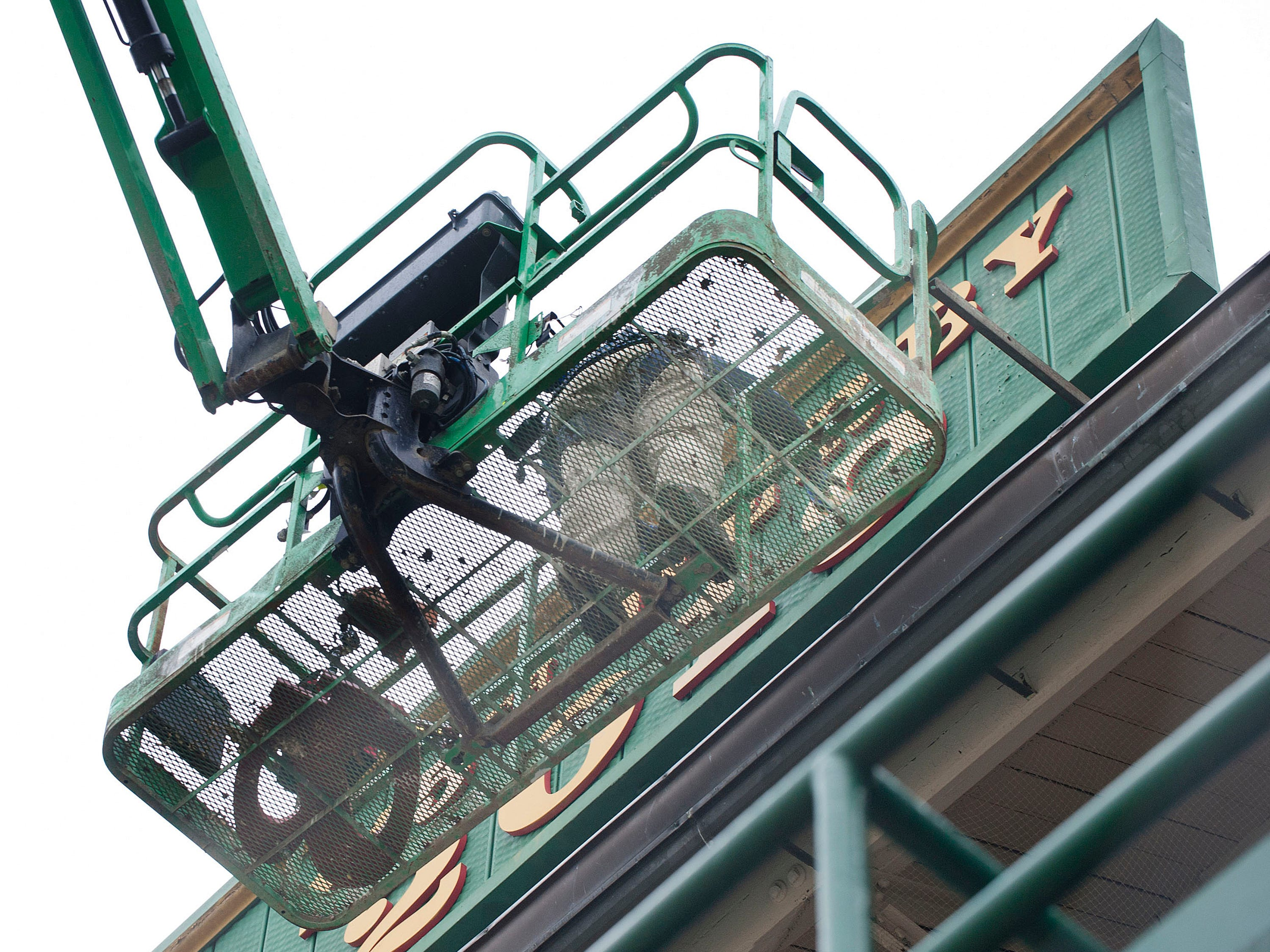 Churchill Downs sign shop worker Todd Herl replaces the number 8 with the number 9, on a sign hung between the twin spires that reflects the current year (2019.)