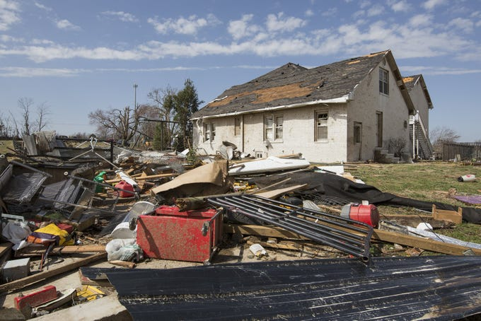 Debris scatters the ground after a tornado touched down in McCracken County, Kentucky on Thursday, March 14, 2019.