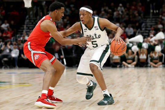 Cassius Winston of Michigan State dribbles while guarded by C.J. Jackson of Ohio State in the first half during the quarterfinals of the Big Ten tournament at the United Center on March 15, 2019 in Chicago.