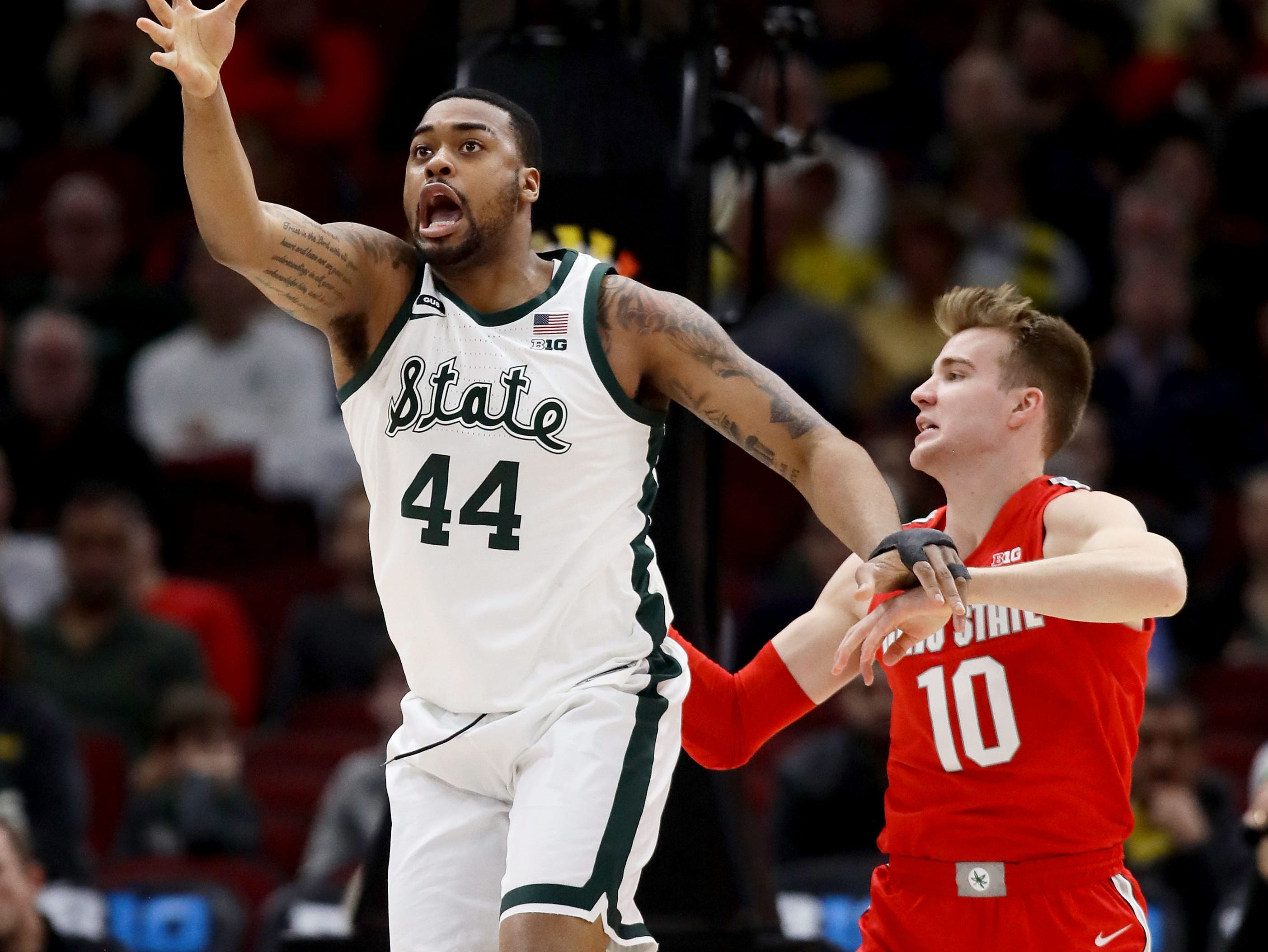 Nick Ward #44 of the Michigan State Spartans reaches for the ball while being guarded by Justin Ahrens #10 of the Ohio State Buckeyes in the first half during the quarterfinals of the Big Ten Basketball Tournament at the United Center on March 15, 2019 in Chicago, Illinois.