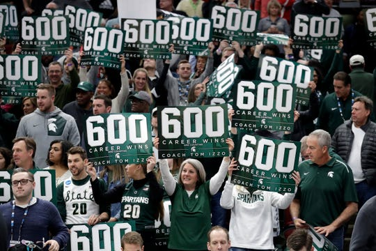 Michigan State fans celebrate head coach Tom Izzo's 600th win after an NCAA college basketball game against Ohio State in the quarterfinals of the Big Ten Conference tournament, Friday, March 15, 2019, in Chicago. Michigan State won 77-70.