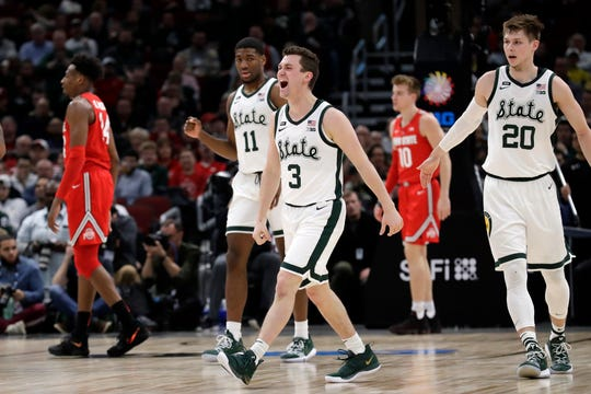 Michigan State's Foster Loyer (3) celebrates after scoring a 3-point basket during the first half of an NCAA college basketball game against Ohio State in the quarterfinals of the Big Ten Conference tournament, Friday, March 15, 2019, in Chicago.