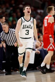 Foster Loyer celebrates in the first half against Ohio State in Chicago on Friday.