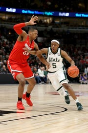 Cassius Winston #5 of the Michigan State Spartans dribbles the ball while being guarded by Kaleb Wesson #34 of the Ohio State Buckeyes in the first half during the quarterfinals of the Big Ten Basketball Tournament at the United Center on March 15, 2019 in Chicago, Illinois.