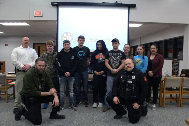 Students in the Mishicot Public Safety Cadets pose with officers from the Mishicot Police Department during their first meeting in February.