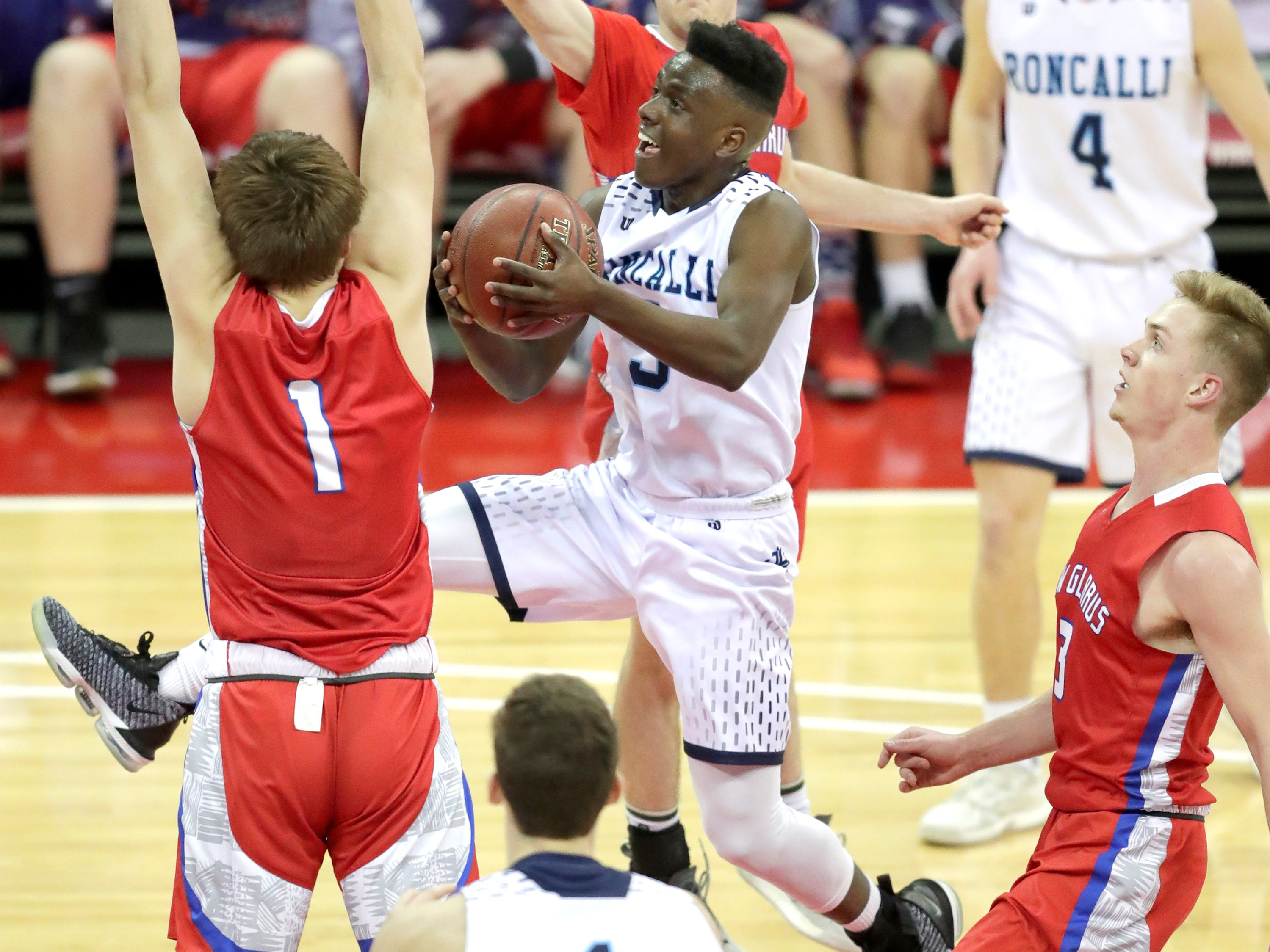 Roncalli's Chombi Lambert eyes the rim during Thursday's WIAA Division 4 state semifinal boys basketball game against New Glarus at the Kohl Center in Madison.
