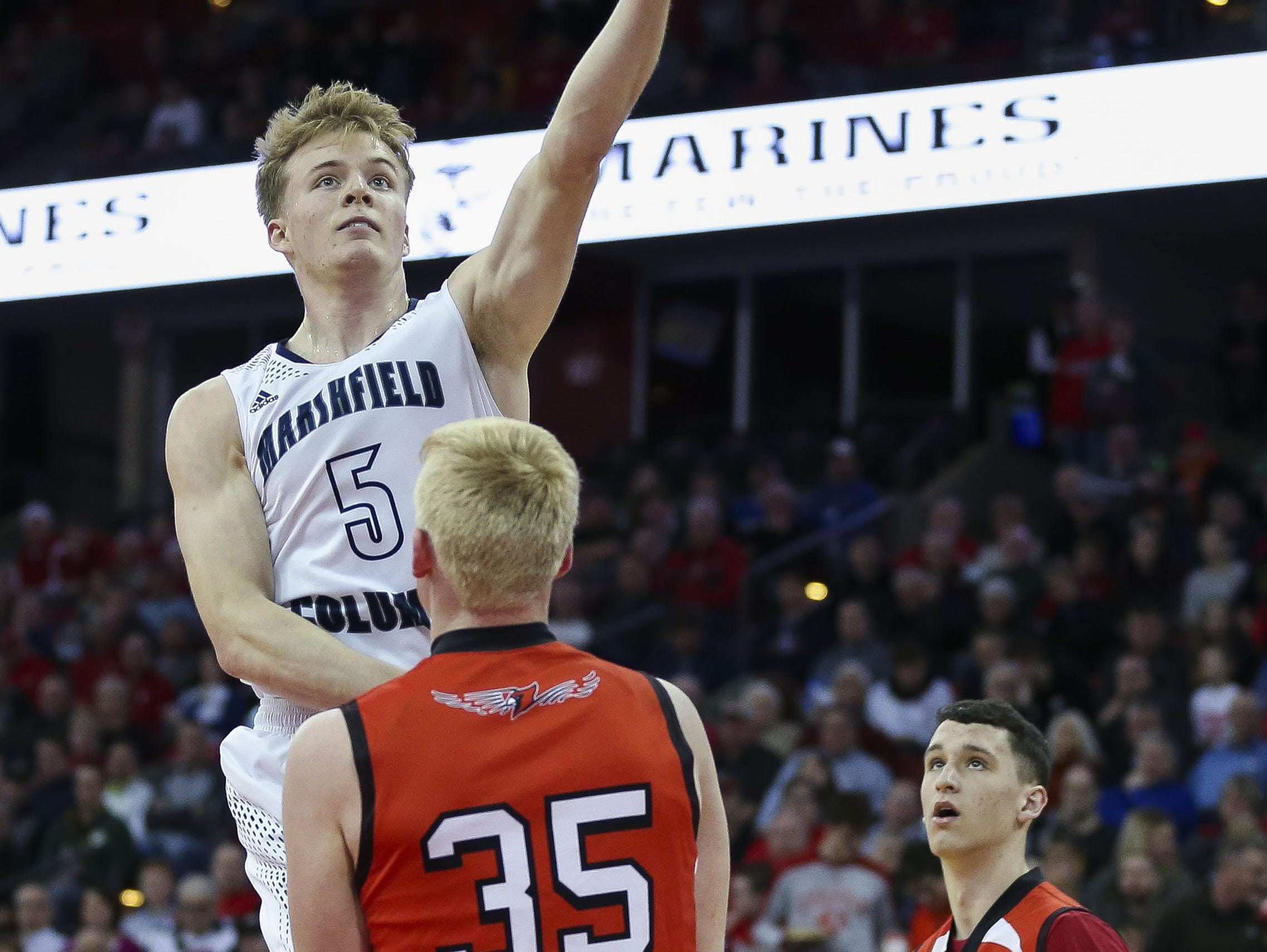 Columbus Catholic High School's Noah Taylor (5) puts up a shot against Bangor High School in a Division 5 boys basketball state semifinal on Friday, March 15, 2019, at the Kohl Center in Madison, Wis. Columbus Catholic won the game, 69-66, on a buzzer-beater 3-pointer. Tork Mason/USA TODAY NETWORK-Wisconsin