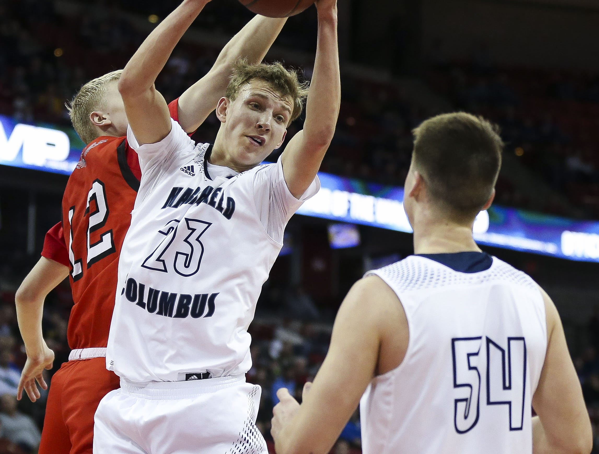 Columbus Catholic High School's Bryce Fuerlinger (23) pulls down a rebound against Bangor High School in a Division 5 boys basketball state semifinal on Friday, March 15, 2019, at the Kohl Center in Madison, Wis. Columbus Catholic won the game, 69-66, on a buzzer-beater 3-pointer. Tork Mason/USA TODAY NETWORK-Wisconsin