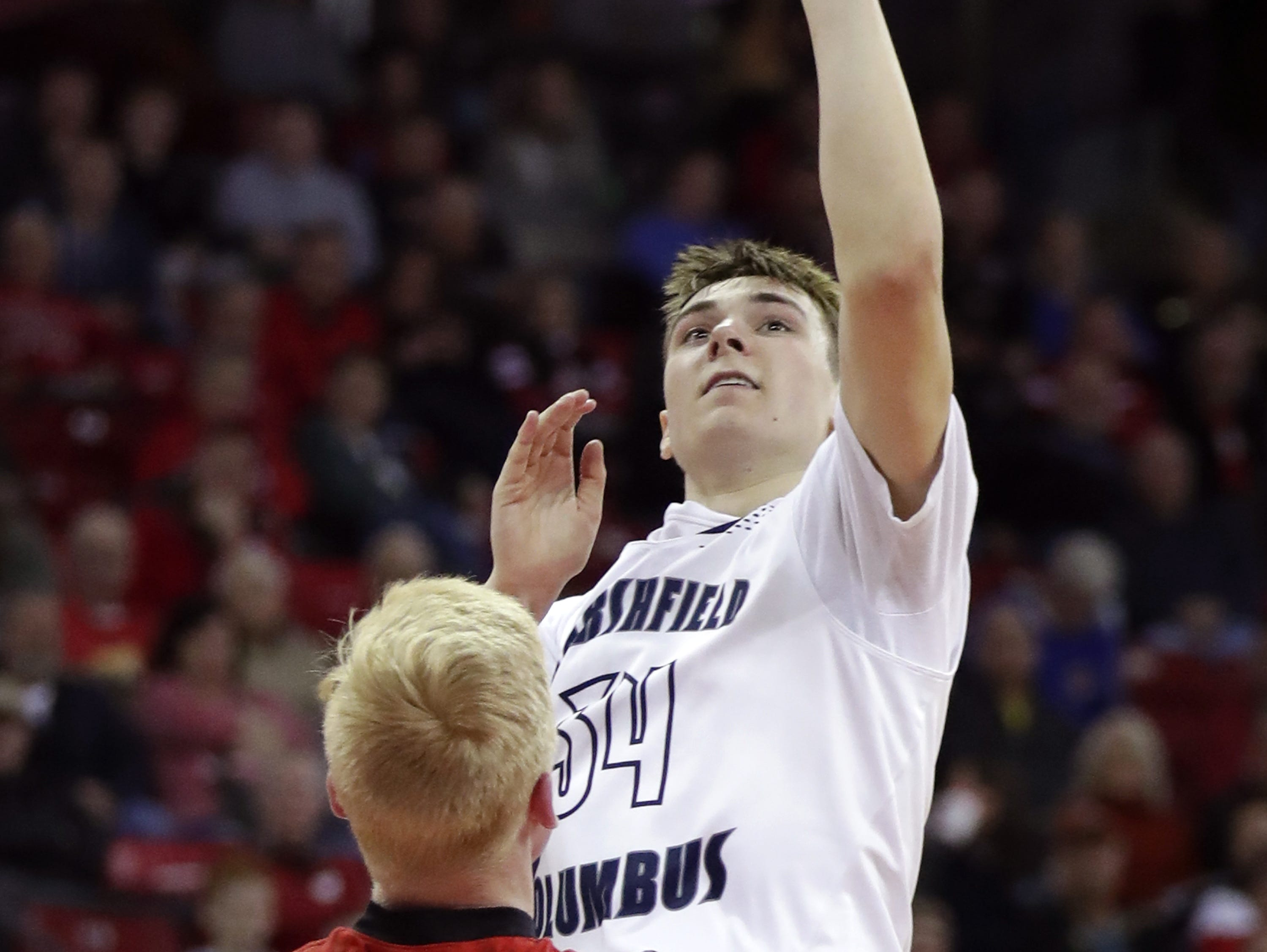 Columbus Catholic High School's #54 Jarred Mandel against Bangor High School's #35 Grant Manke during their WIAA Division 5 boys basketball state semifinal on Friday, March 15, 2019, at the Kohl Center in Madison, Wis. Clumbus defeated Bangor 69 to 66. Wm. Glasheen/USA TODAY NETWORK-Wisconsin.