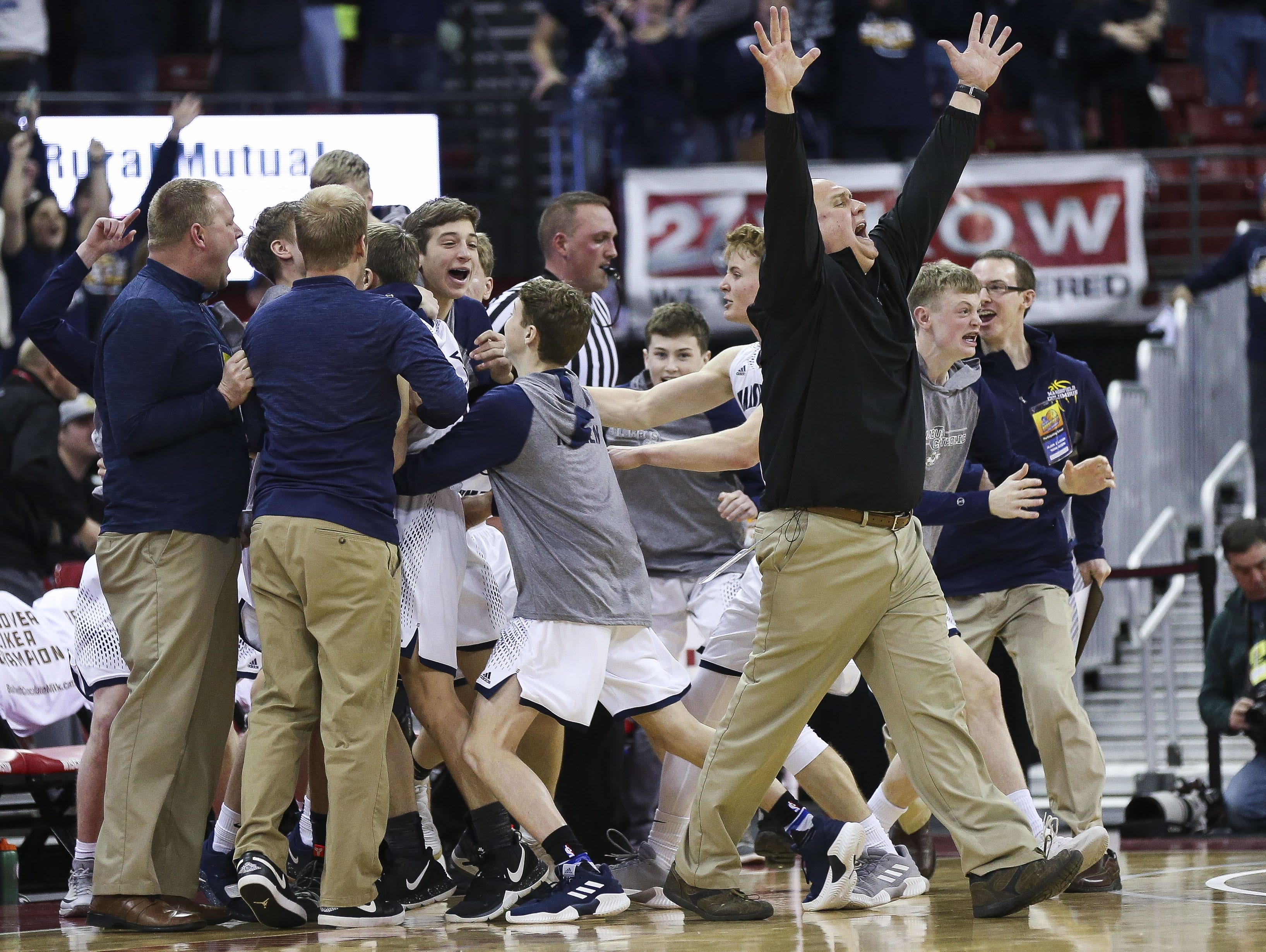 Columbus Catholic High School head coach Joe Kinieczny celebrates after a buzzer-beater 3-pointer by Tom Nystrom to beat Bangor High School, 69-66, a Division 5 boys basketball state semifinal on Friday, March 15, 2019, at the Kohl Center in Madison, Wis. Tork Mason/USA TODAY NETWORK-Wisconsin