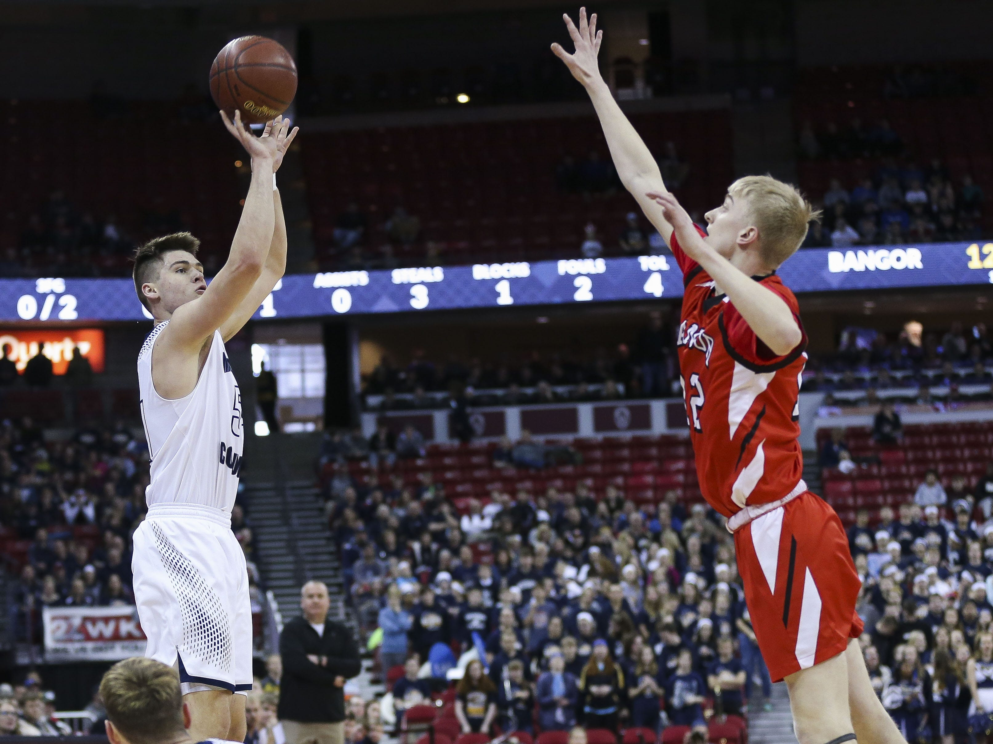 Columbus Catholic High School's Jarred Mandel (54) shoots a 3-pointer against Bangor High School in a Division 5 boys basketball state semifinal on Friday, March 15, 2019, at the Kohl Center in Madison, Wis. Columbus Catholic won the game, 69-66, on a buzzer-beater 3-pointer. Tork Mason/USA TODAY NETWORK-Wisconsin