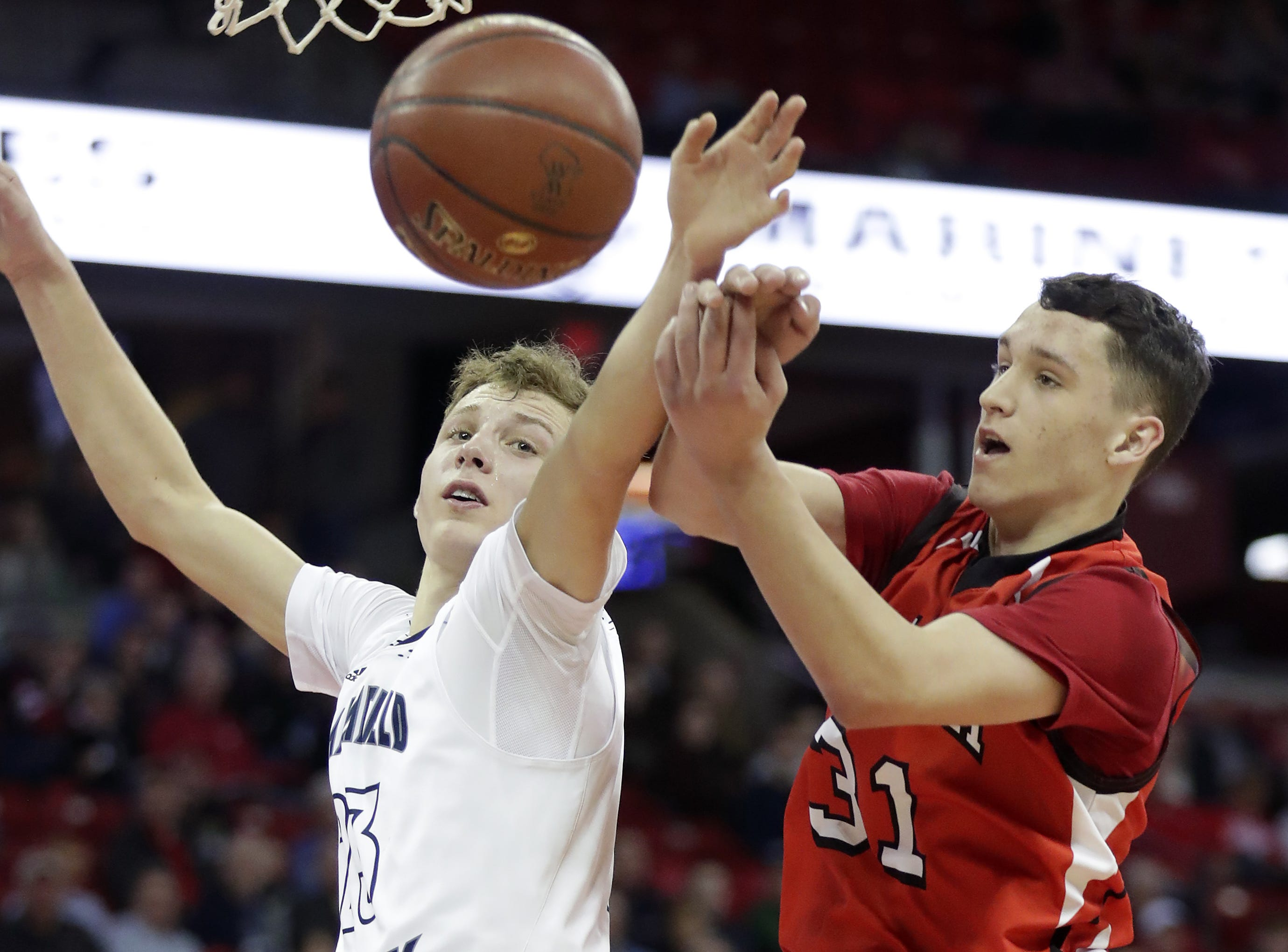Columbus Catholic High School's #23 Bryce Fuerlinger rebounds against Bangor High School's #31 Hank Reader during their WIAA Division 5 boys basketball state semifinal on Friday, March 15, 2019, at the Kohl Center in Madison, Wis. Clumbus defeated Bangor 69 to 66. Wm. Glasheen/USA TODAY NETWORK-Wisconsin.