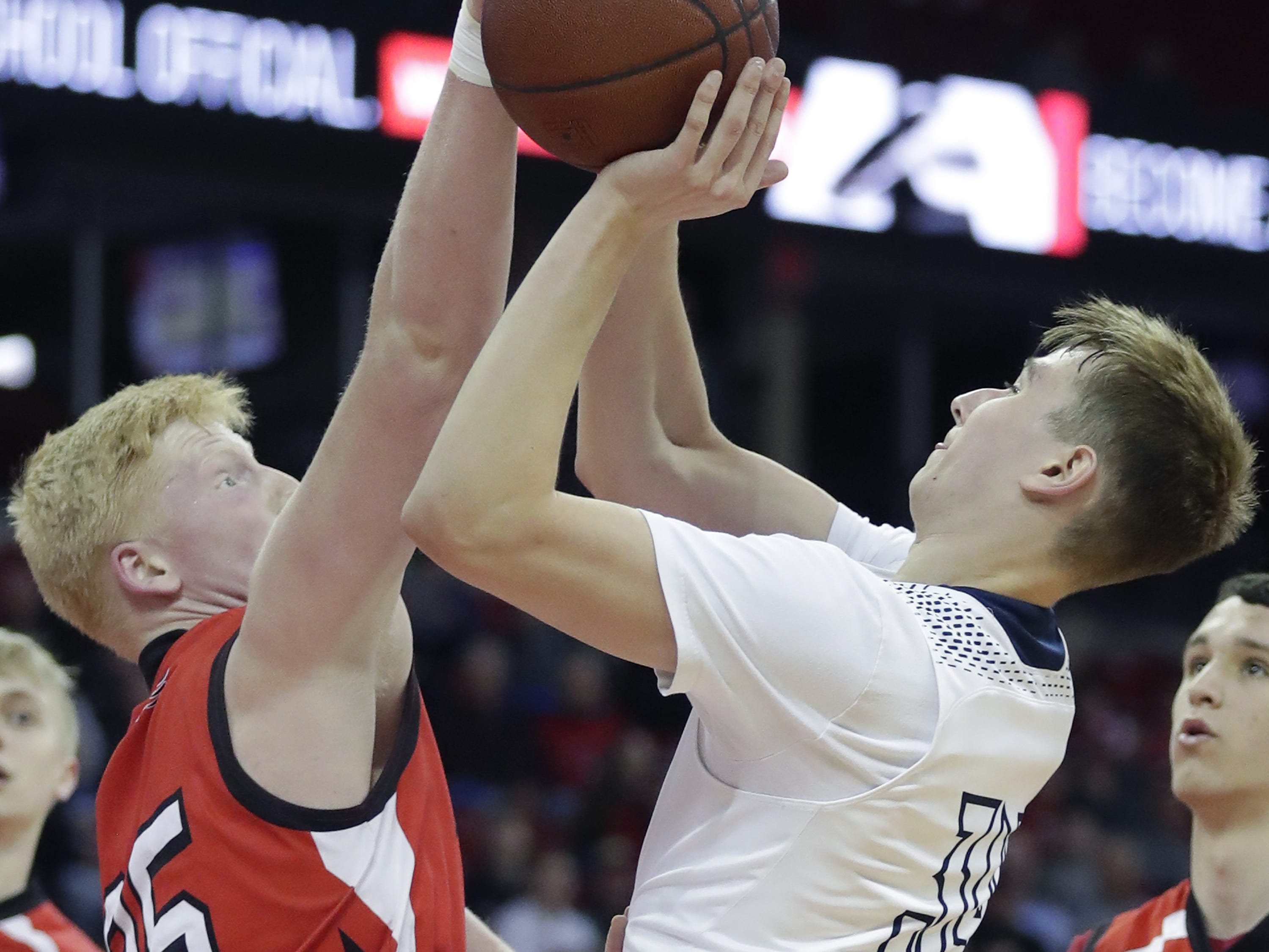 Columbus Catholic High School's #34 Ethan Meece against Bangor High School's #35 Grant Manke during their WIAA Division 5 boys basketball state semifinal on Friday, March 15, 2019, at the Kohl Center in Madison, Wis. Clumbus defeated Bangor 69 to 66. Wm. Glasheen/USA TODAY NETWORK-Wisconsin.