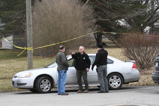Mansfield police detectives tape off a possible crime scene during a backyard search Friday on Floral Court.