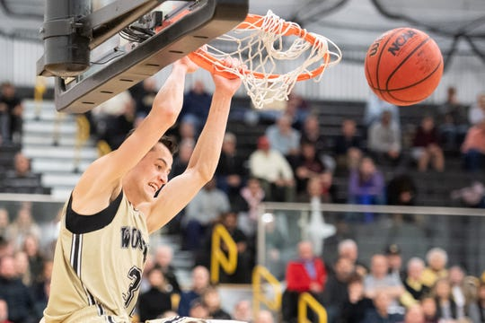 River Valley grad Danyon Hempy dunks the ball in a game for The College of Wooster during a game this season. Hempy averaged 20.6 points this year.