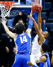 Memphis forward Isaiah Maurice (left) blocks the shot of UCF guard BJ Taylor  (right) during action in their quarterfinal round AAC Tournament game at the FedExForum, Friday, March 15, 2019.